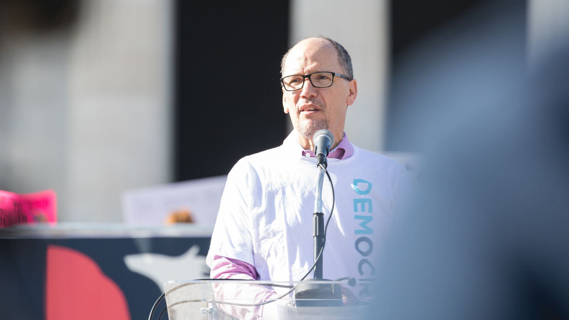 Tom Perez speaks at a microphone.