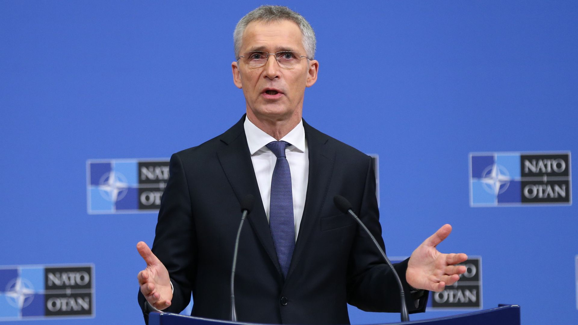 NATO Secretary General Jens Stoltenberg speaking at a lectern