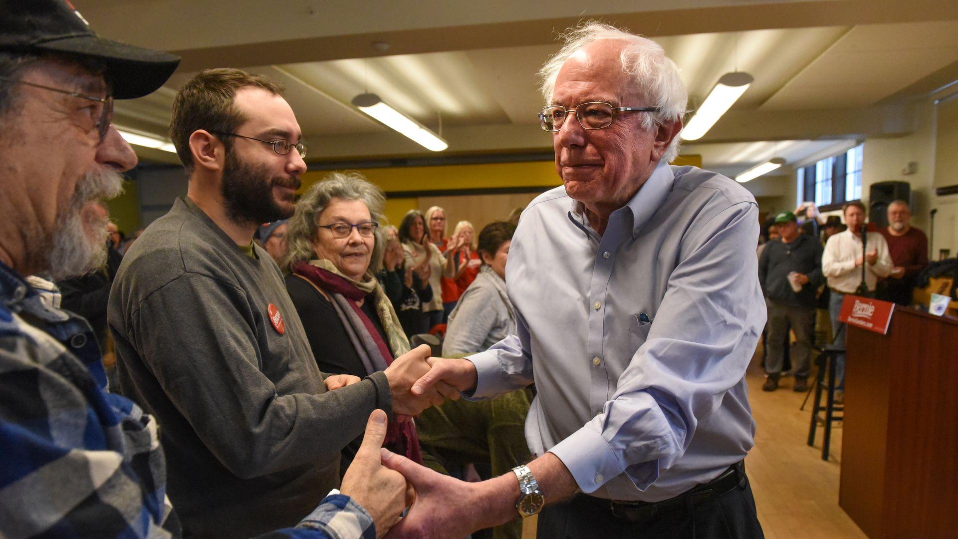 Bernie Sanders shaking hands