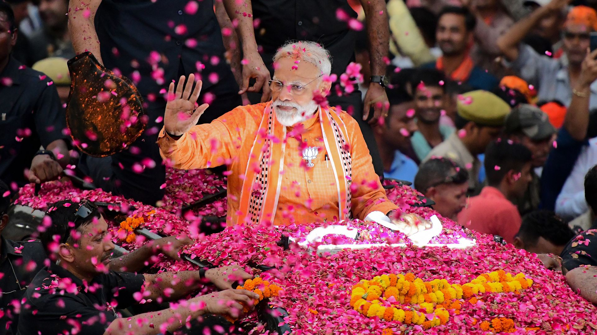 Indian Prime Minister and leader of the Bharatiya Janata Party (BJP) Narendra Modi gestures during a roadshow in Varanasi on April 25, 2019.