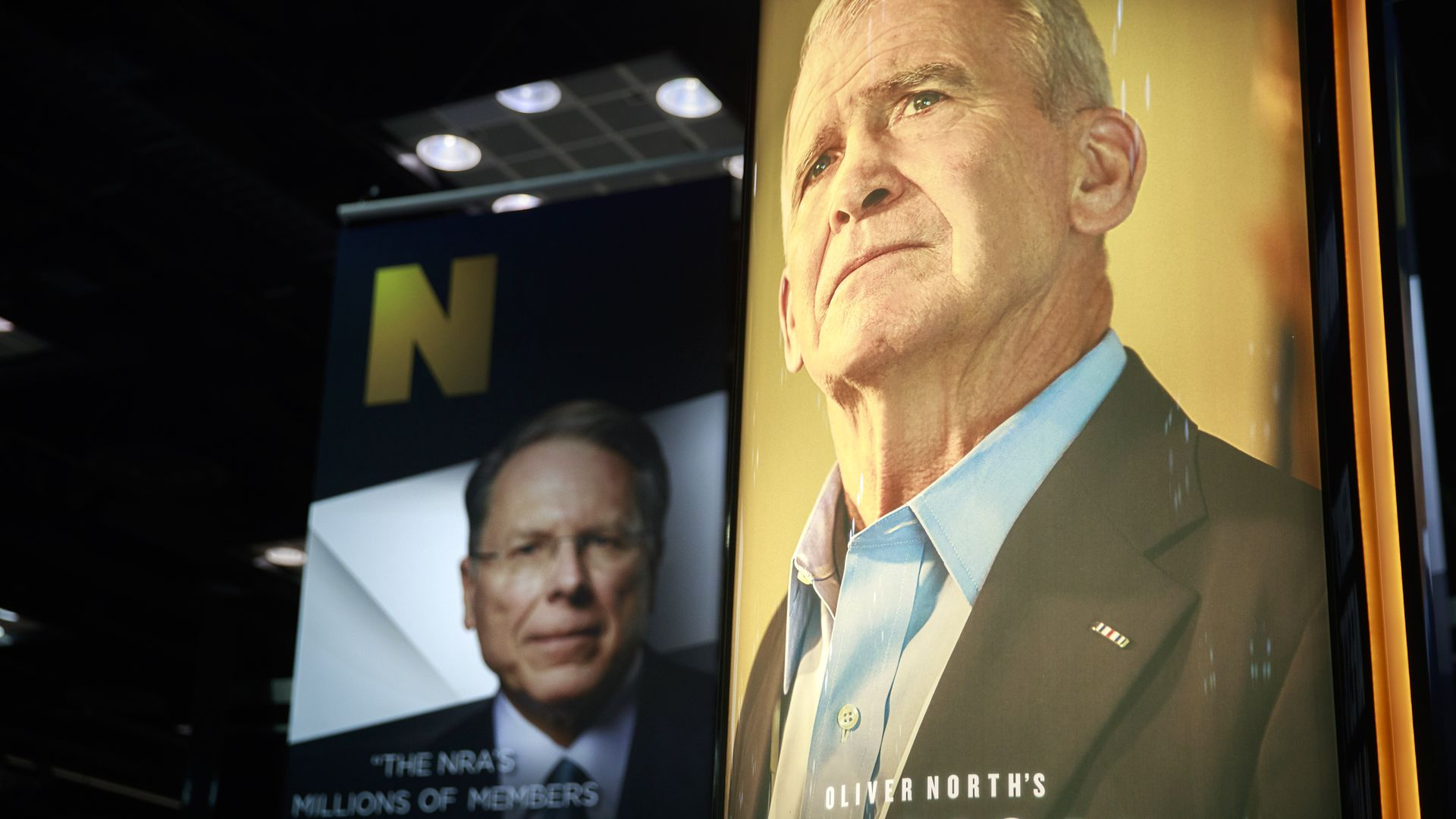 Photos of NRA Chief Executive and Executive Vice President Wayne LaPierre (L) and former president of the NRA Oliver North.