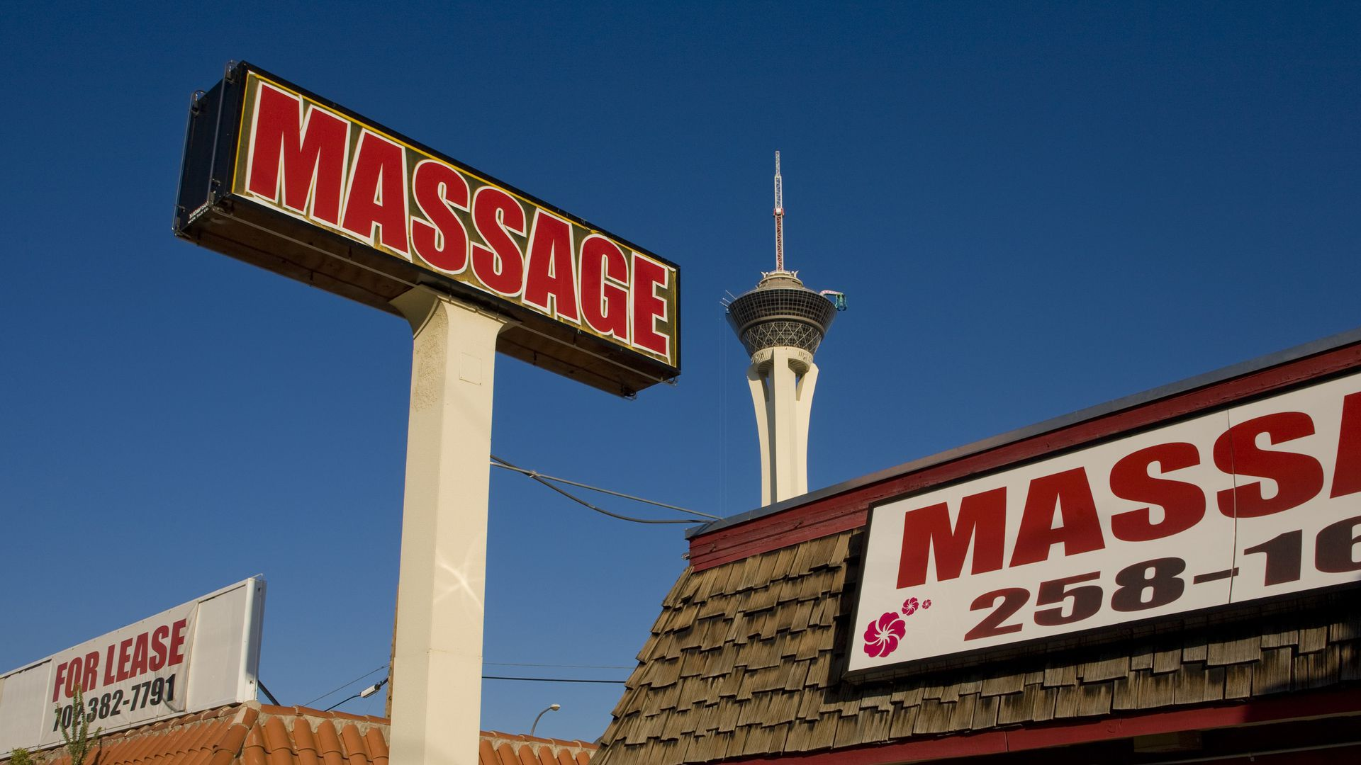 """A sign that says """"massage"""" outside a building"""