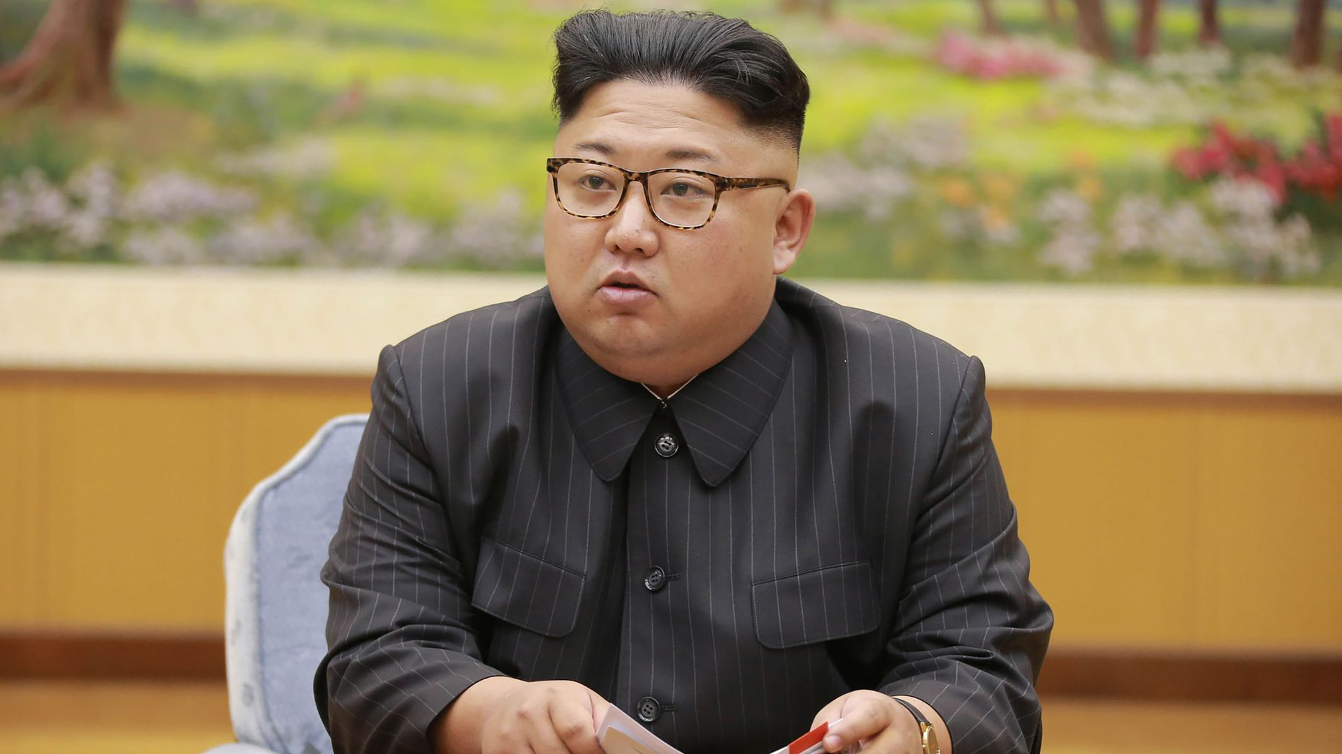 North Korean leader Kim Jong-Un attending a meeting with a committee of the Workers' Party of Korea.