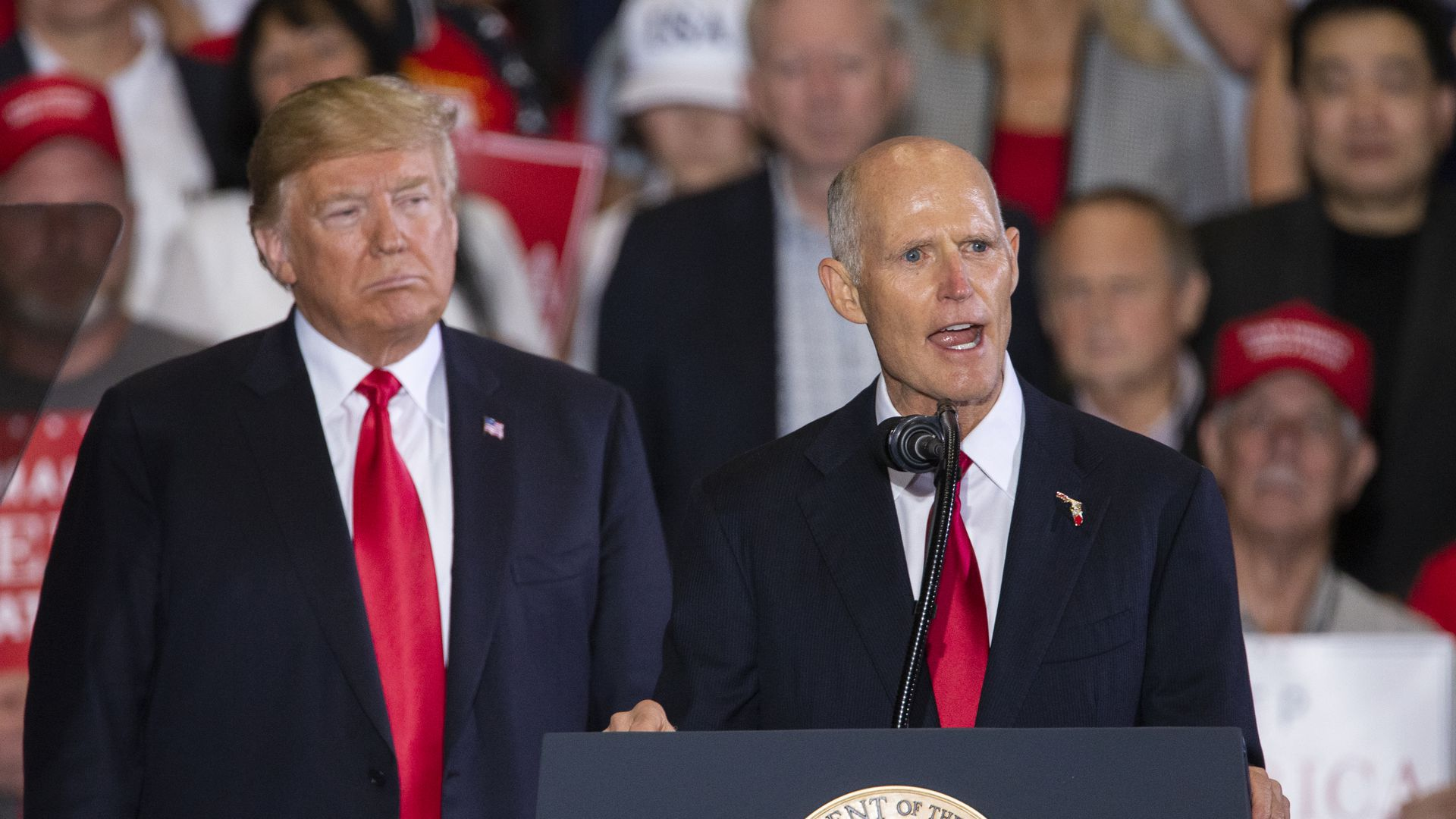 President Trump stands with Rick Scott at a campaign rally