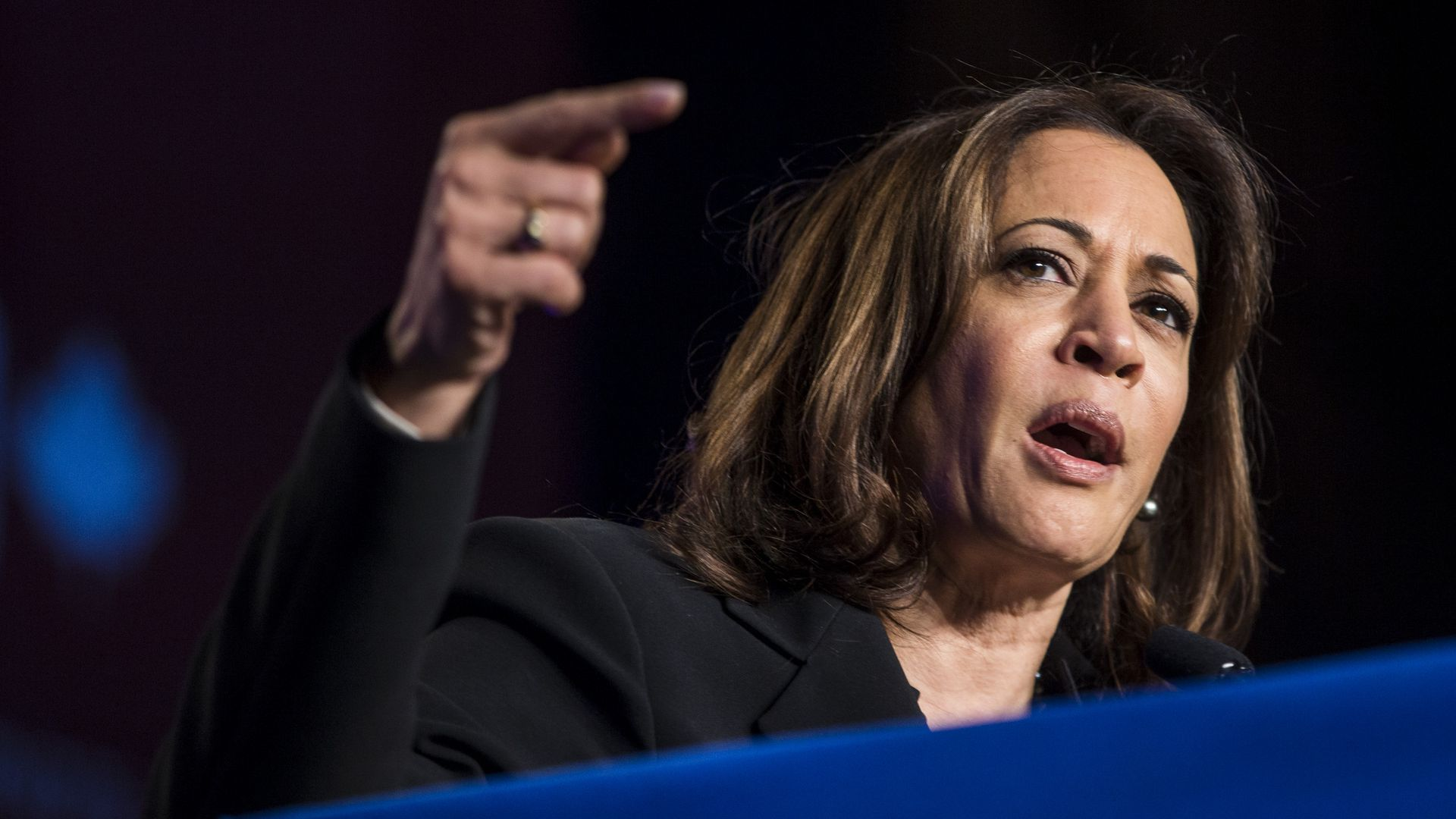 In this image, Kamala Harris speaks and points.