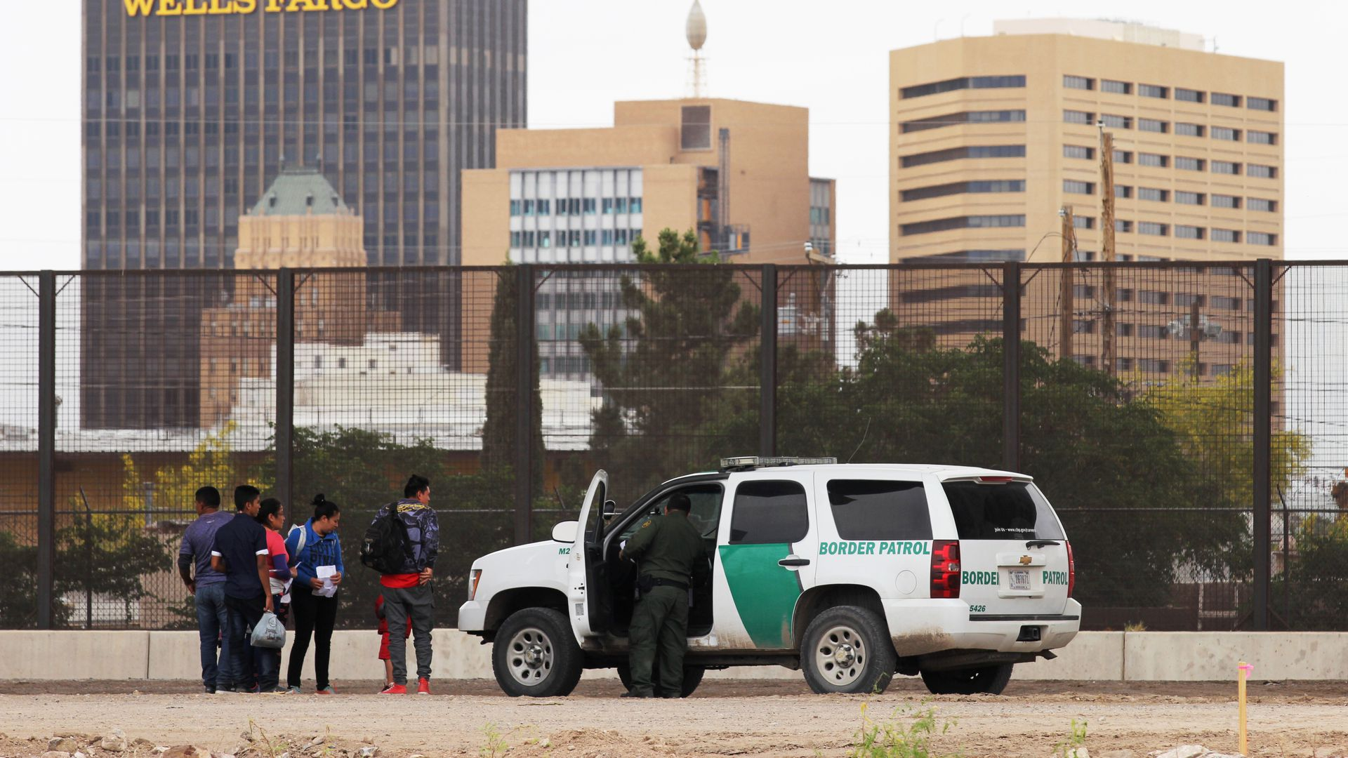Central American migrants detained by U.S. Customs and Border Patrol agents on the border between El Paso, Texas