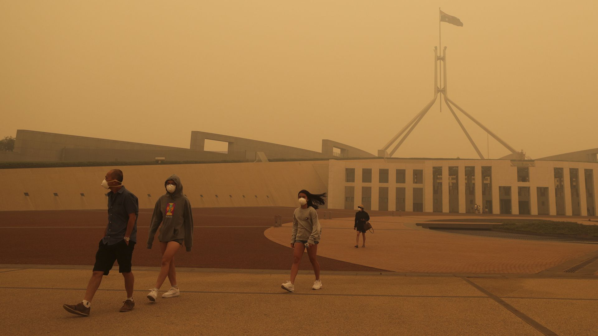 Visitors to Parliament House are forced to wear face masks after smoke from bushfires blankets Canberra in a haze with hazardous air quality on January 5, 2020 in Canberra, Australia