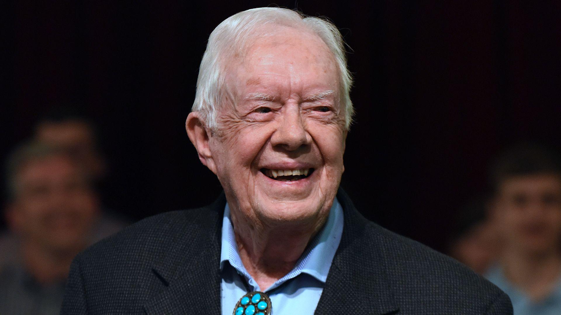 Carter smiling.