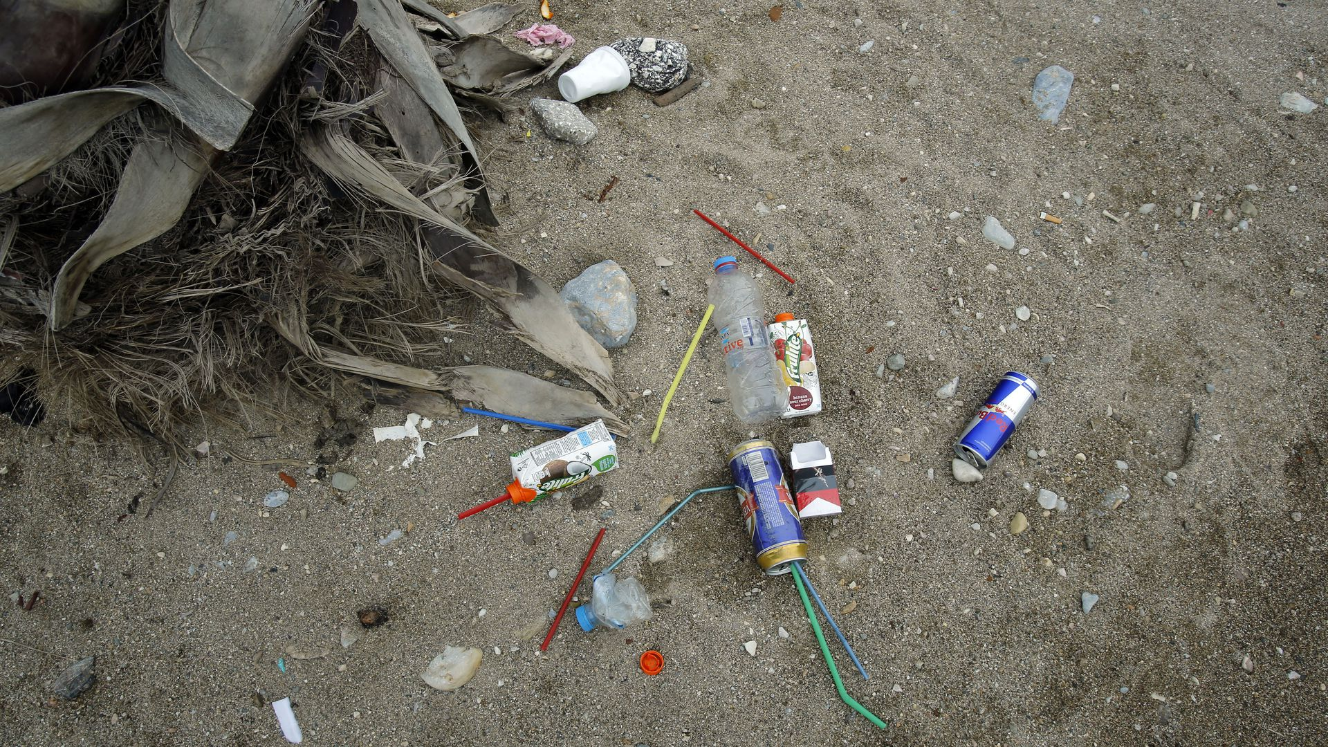 Plastic litter in sand
