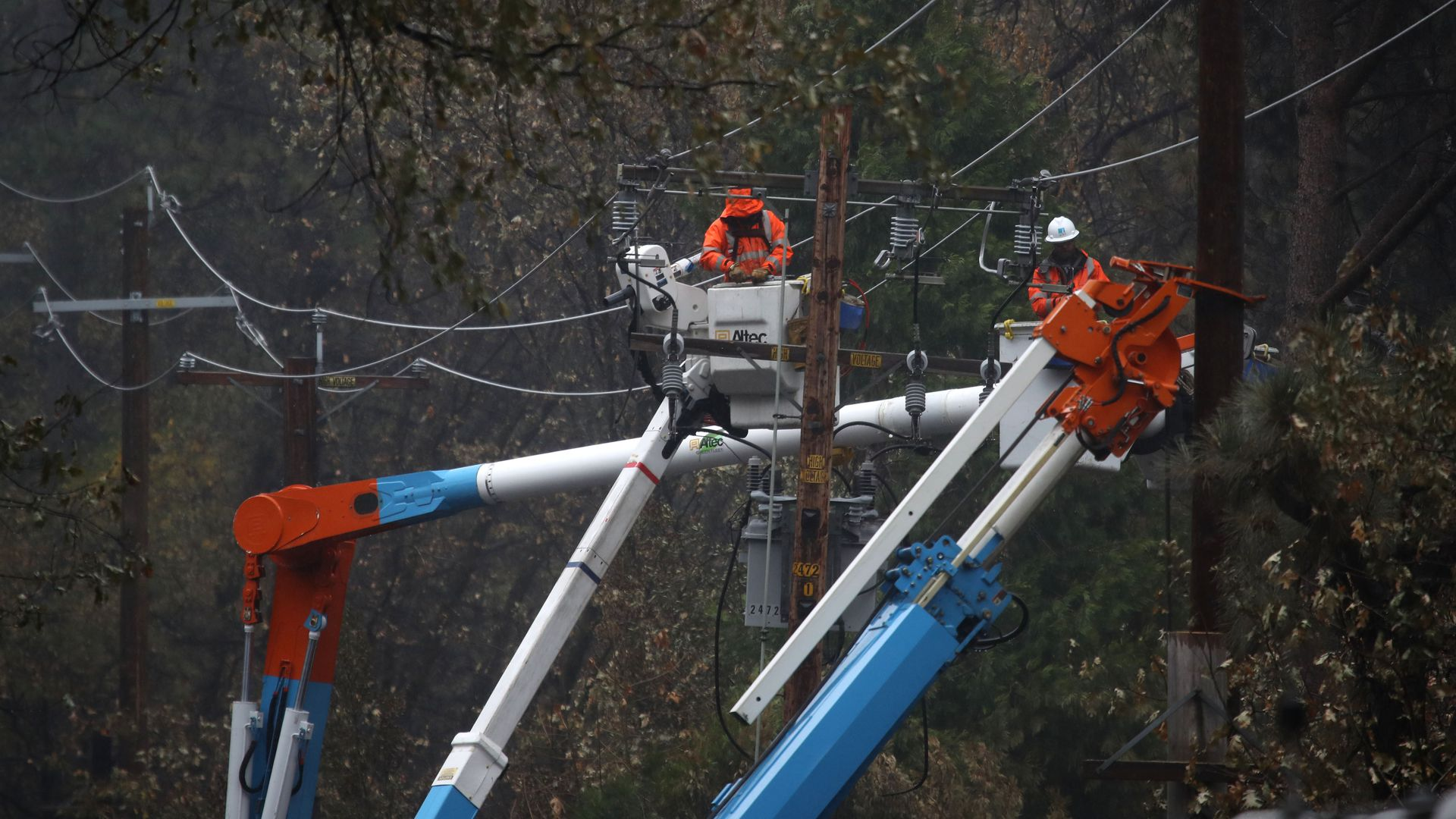 Pacific Gas and Electric (PG&E) crews repair power lines that were destroyed by the Camp Fire