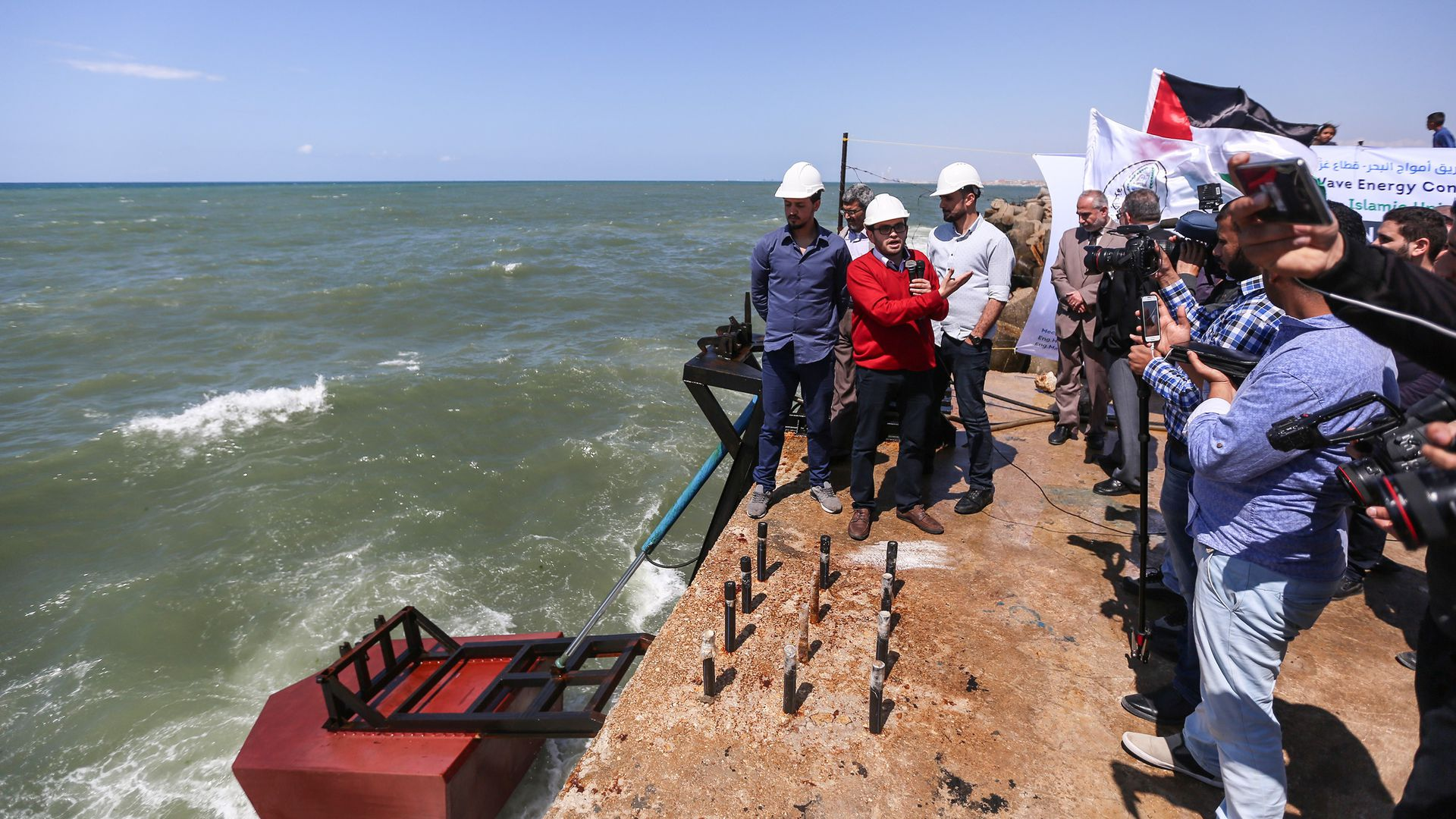 Palestinian academicians of Islamic University of Gaza attend the publicity ceremony of a tidal wave energy project at Gaza Port in Gaza City, Gaza, on April 22, 2018.