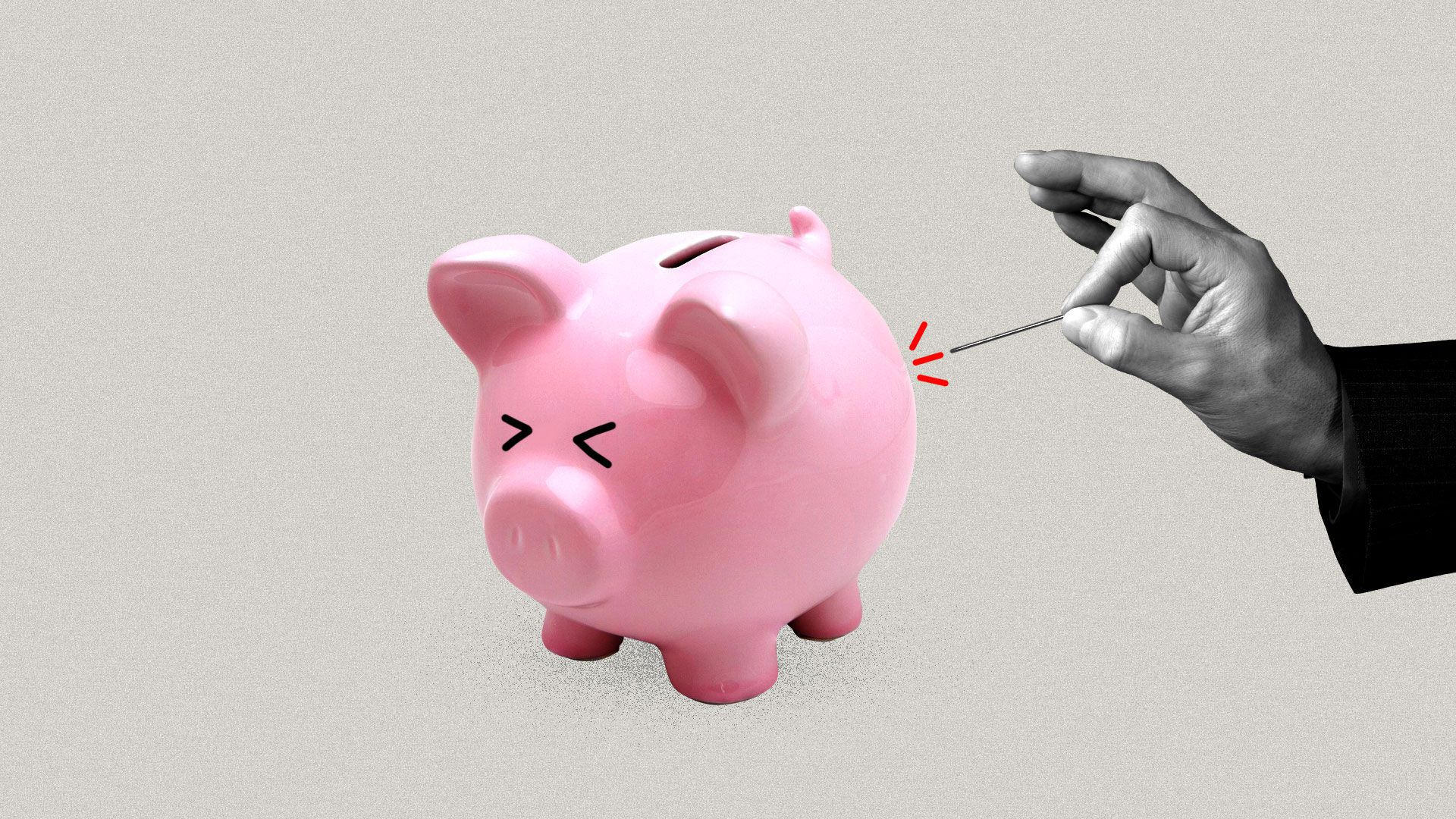 A hand with a pin poking a piggy bank