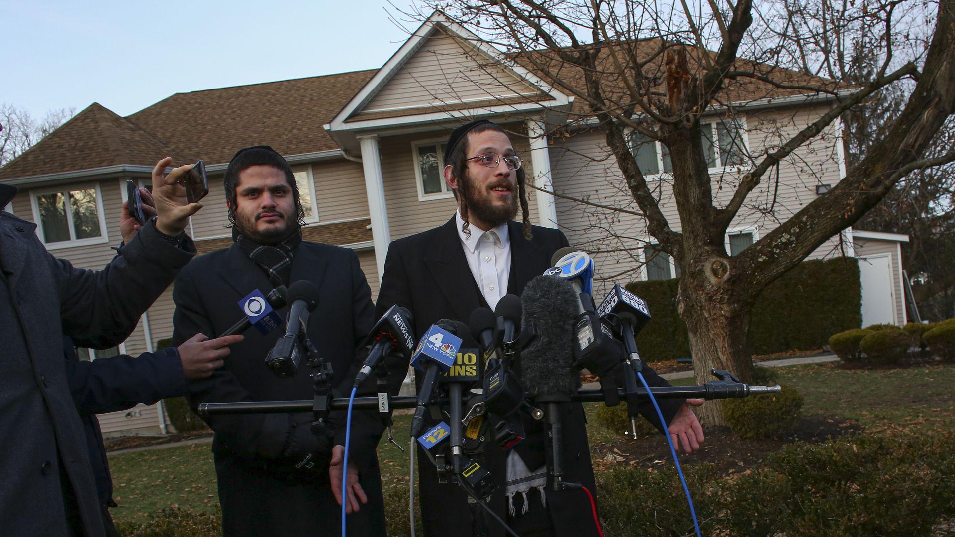 Orthodox Jew speaking outside of rabbi's home