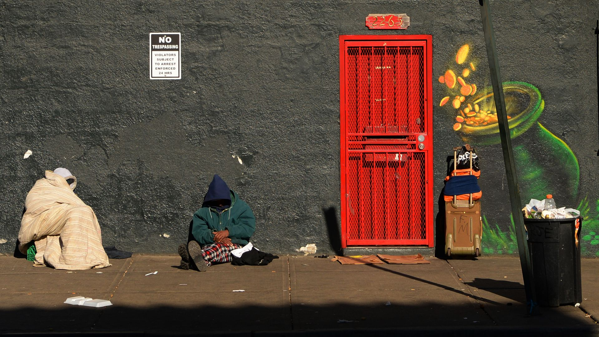 Photo of people experiencing homeless on a street in downtown Denver