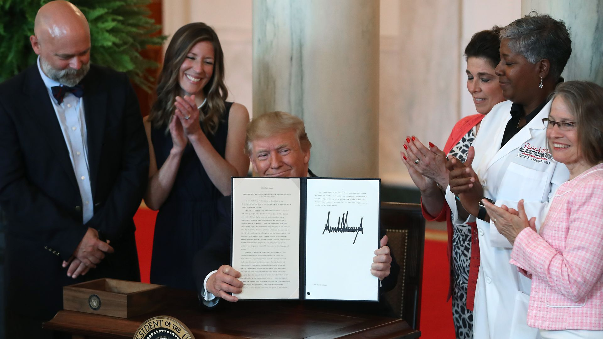 President Trump signs a health care executive order.