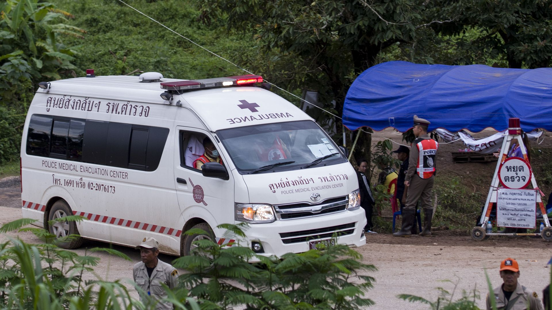 An ambulance sits outside the Tham Luang cave area during rescue operations.
