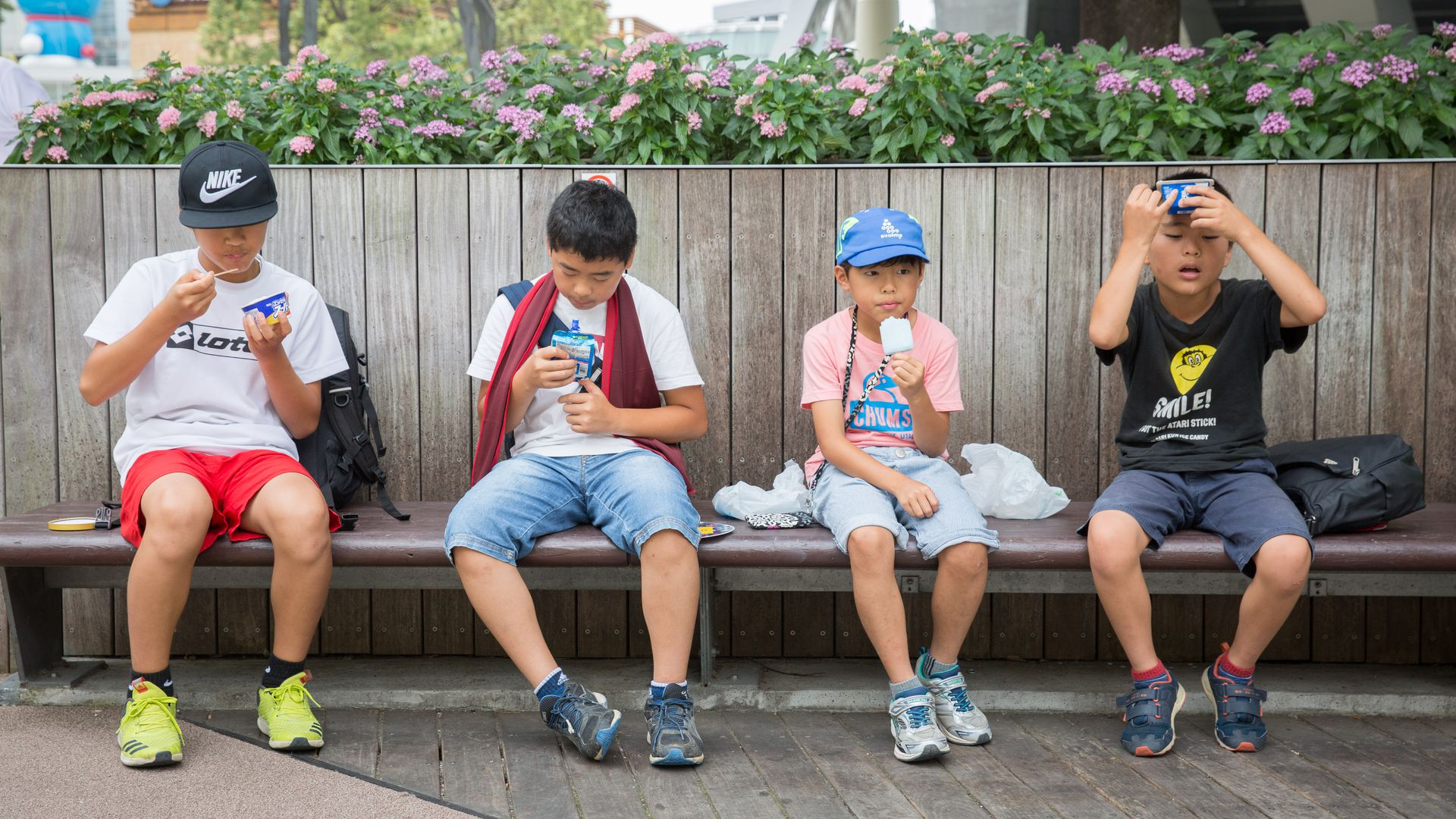 Children eat ice creams as they try and keep cool on July 22, 2018 in Roppongi, Tokyo, Japan.