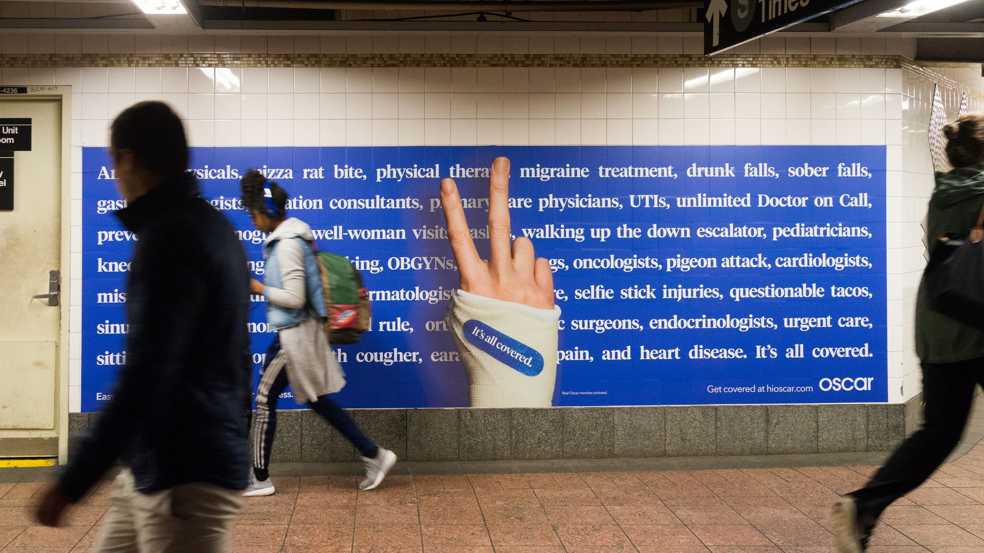 An advertisement for Oscar health insurance in a New York subway.