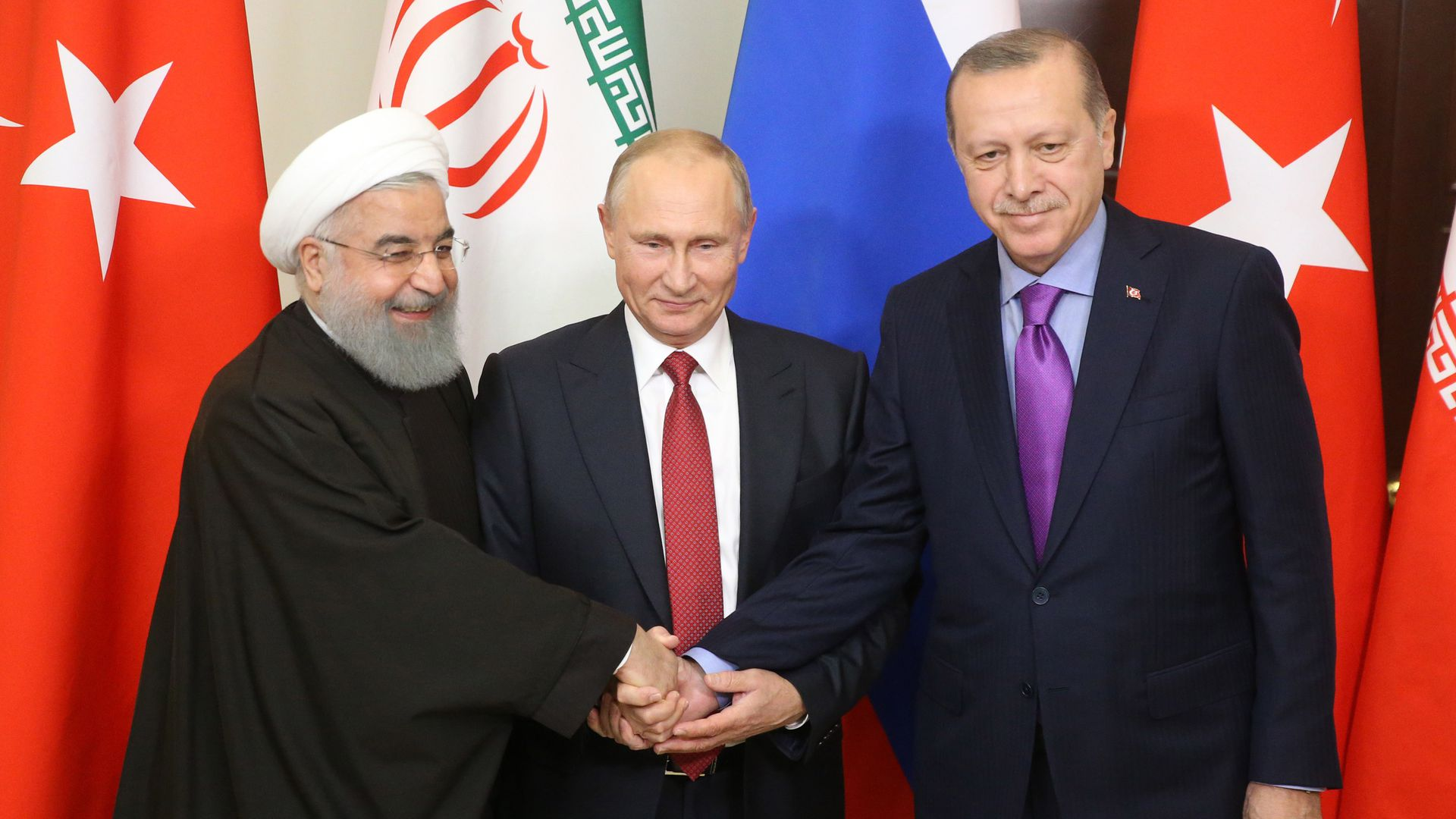 Russian President Vladimir Putin pose for a photo with Turkish President Recep Tayyip Erdogan and Iranian President Hassan Rouhani prior to their talks at Black Sea resort state residence