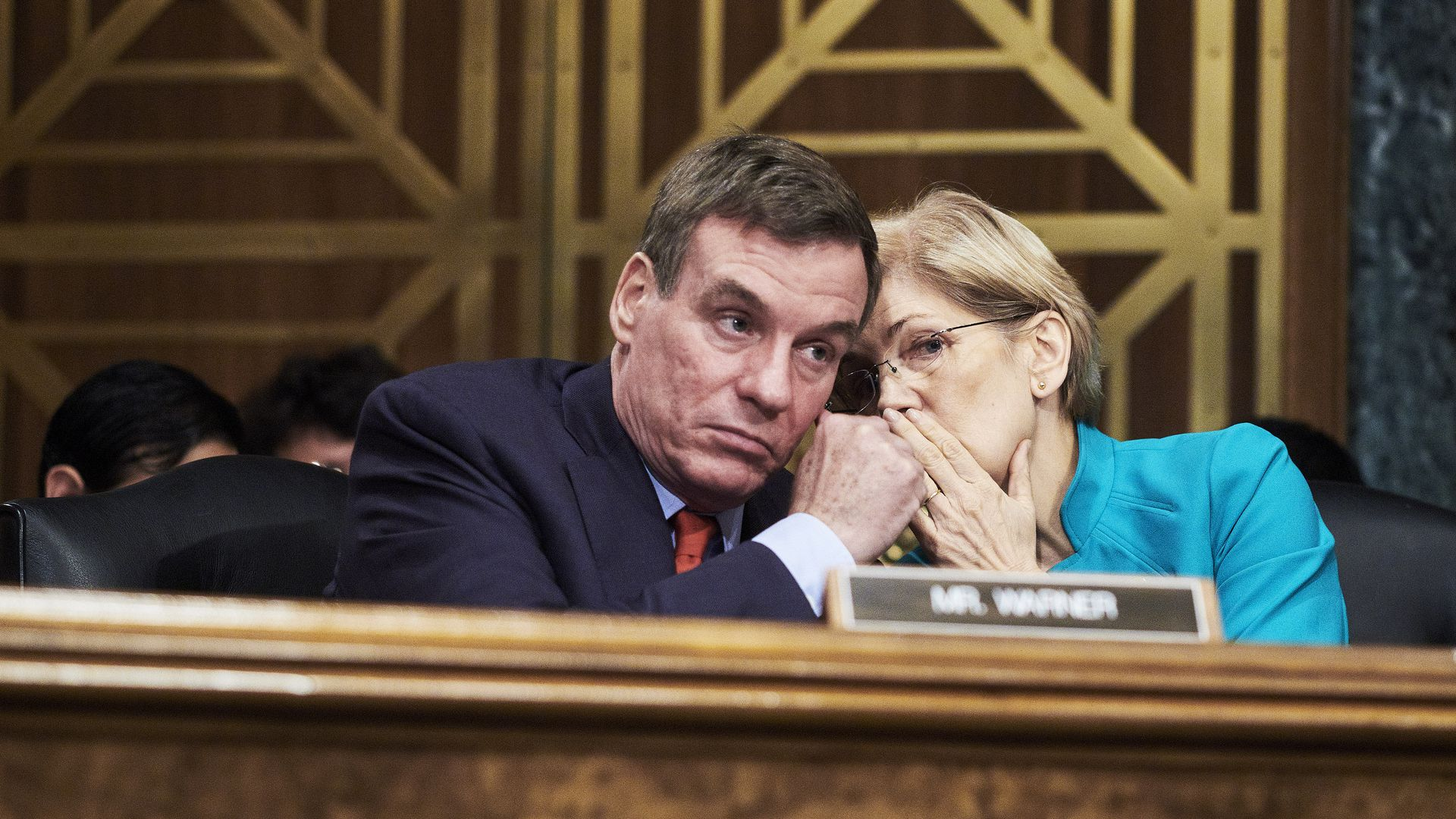 Senators Mark Warner and Elizabeth Warren.