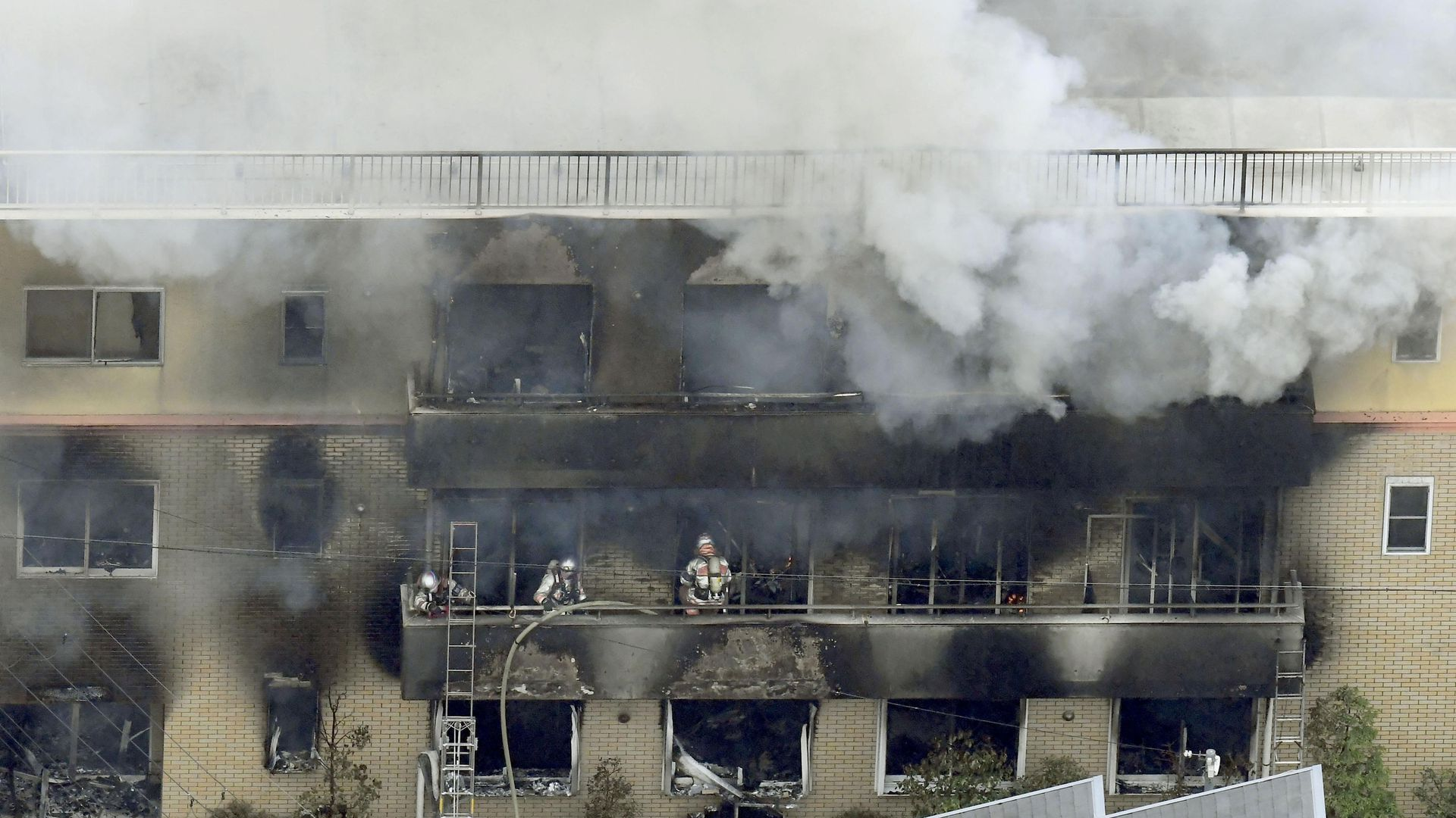 Firefighters battle a blaze at Kyoto Animation in Japan.