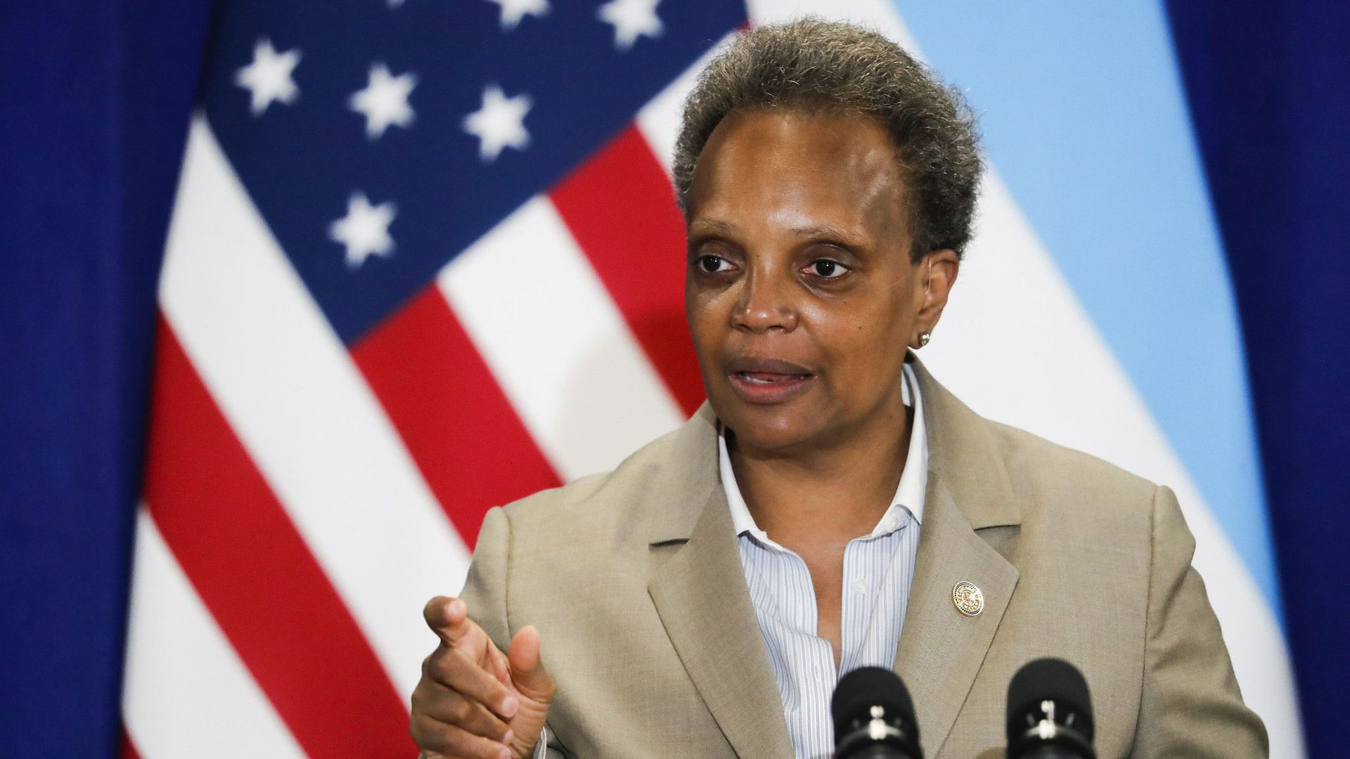 Chicago Mayor Lori Lightfoot speaks in front of a microphone