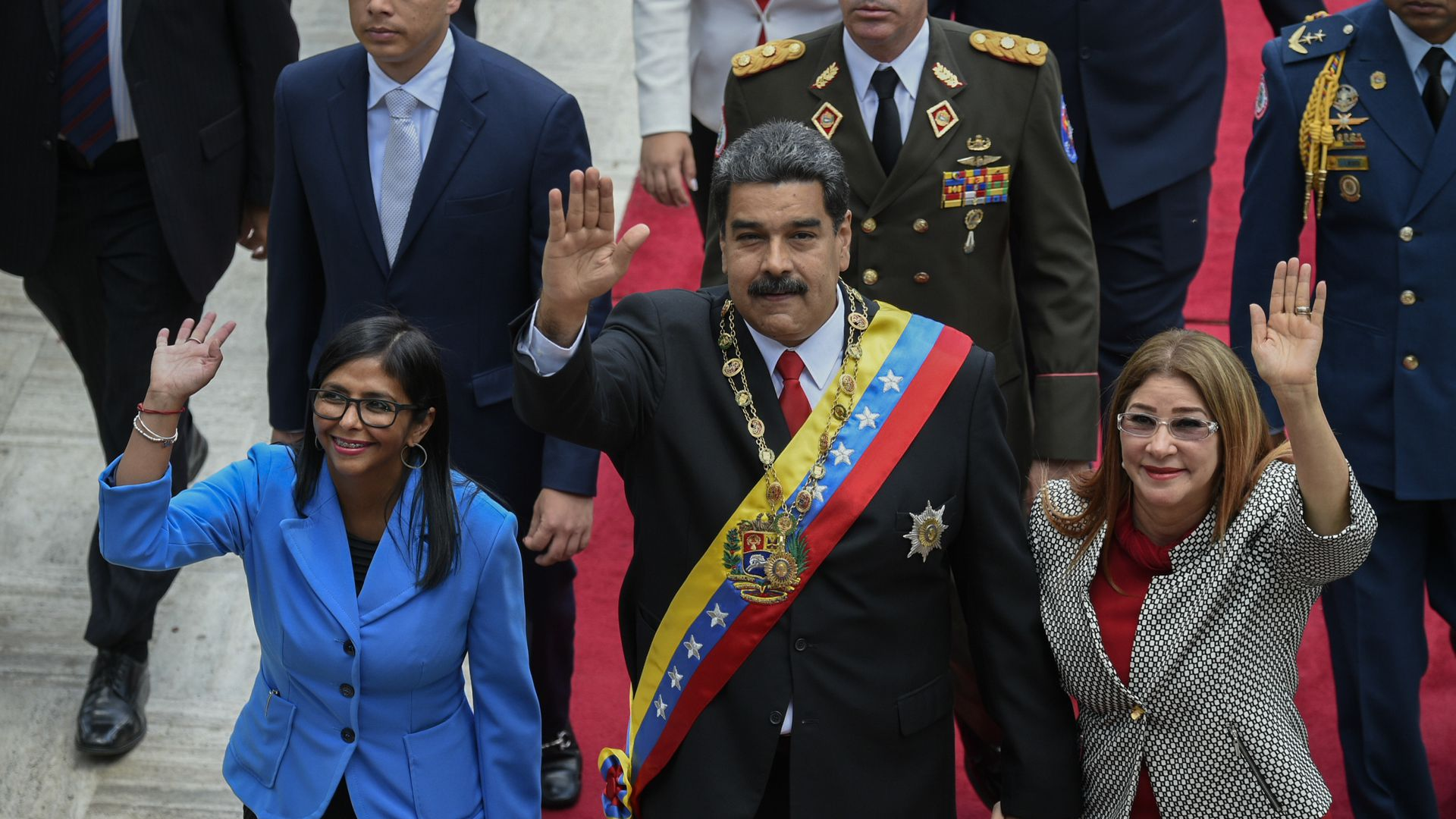 Maduro and wife and other officials waving
