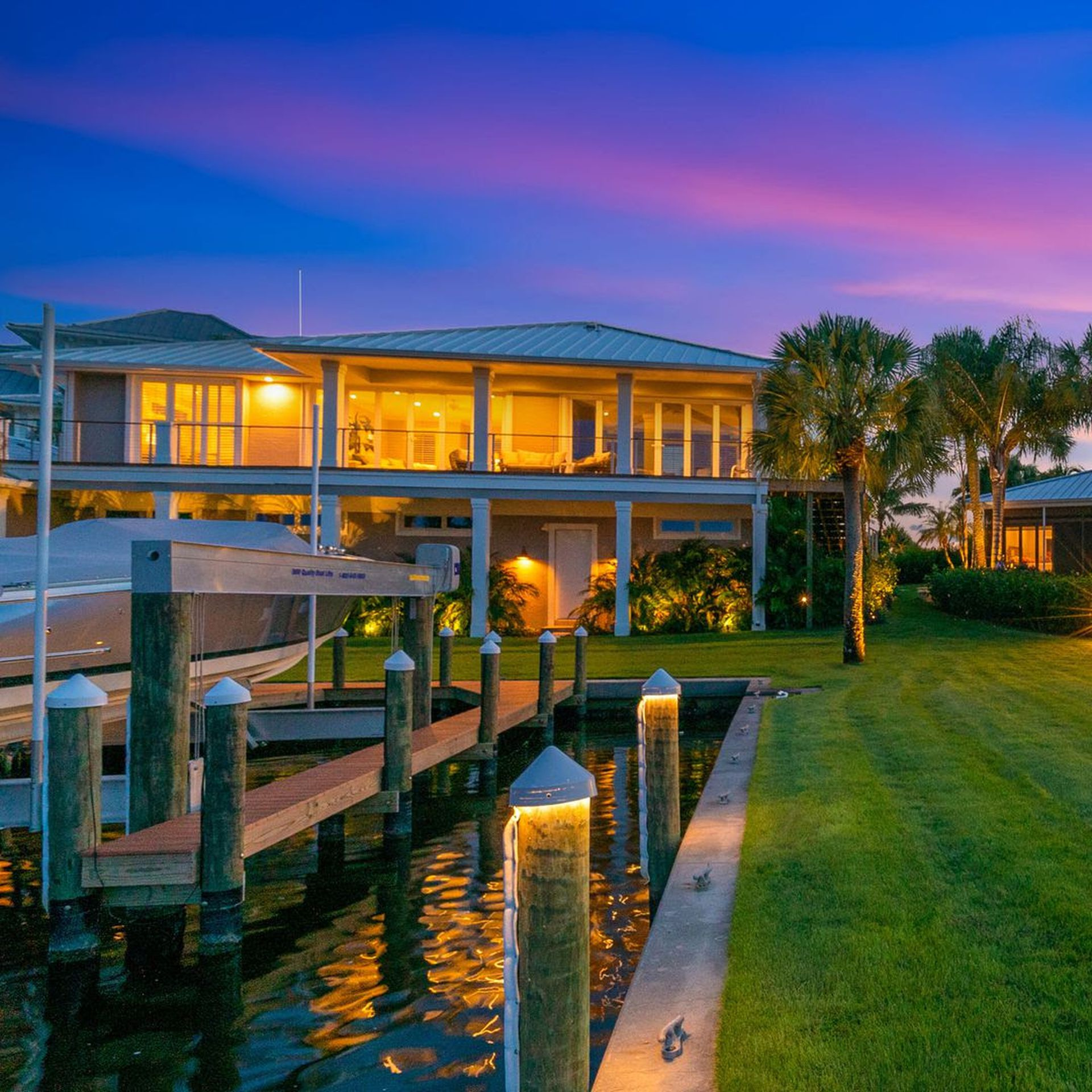 A photo of the front yard of a house listed for sale in Casey Key.