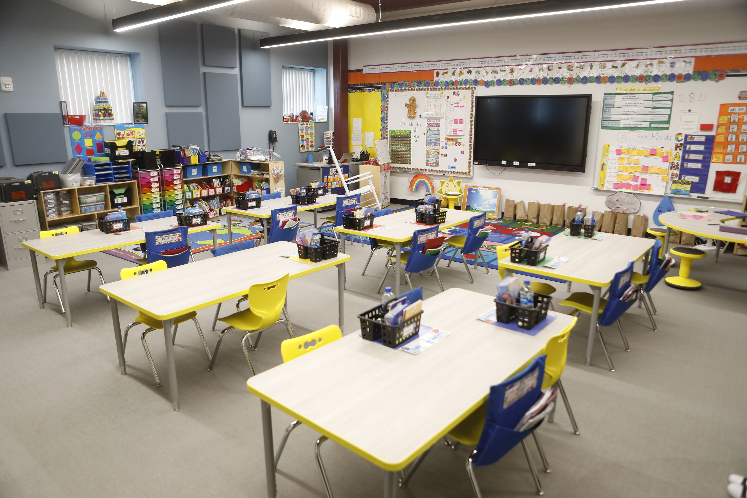 A photograph of a classroom inside the newly renovated Tampa Heights Elementary School, with desks and brightly colored chairs.