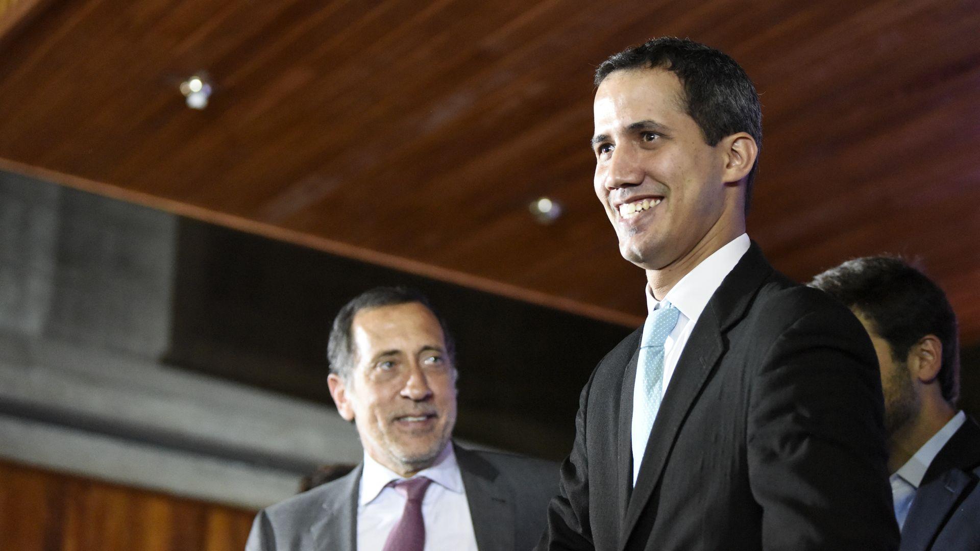Juan Guaido smiles.