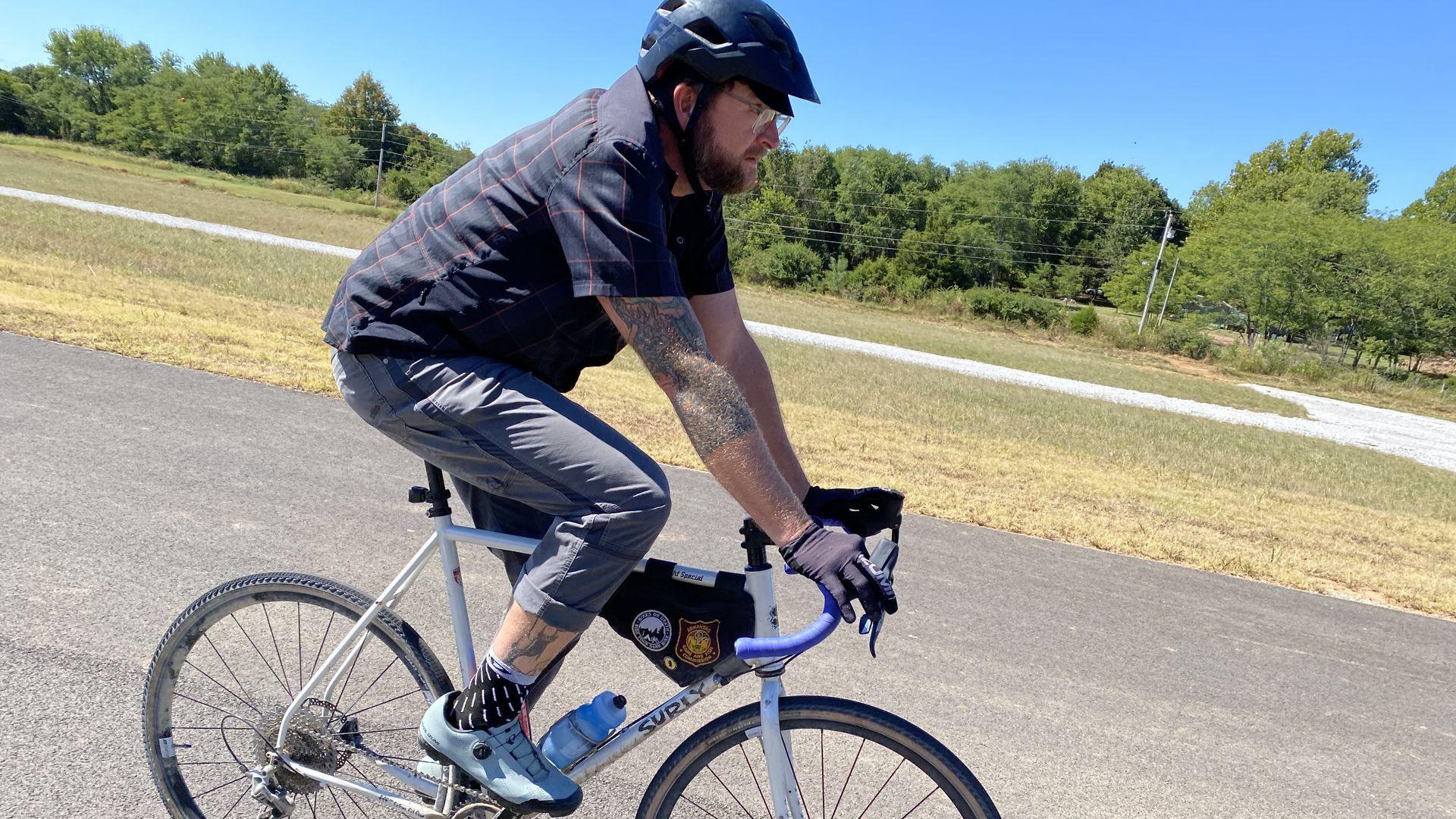 A man rides a bike on a cyclo-cross course.