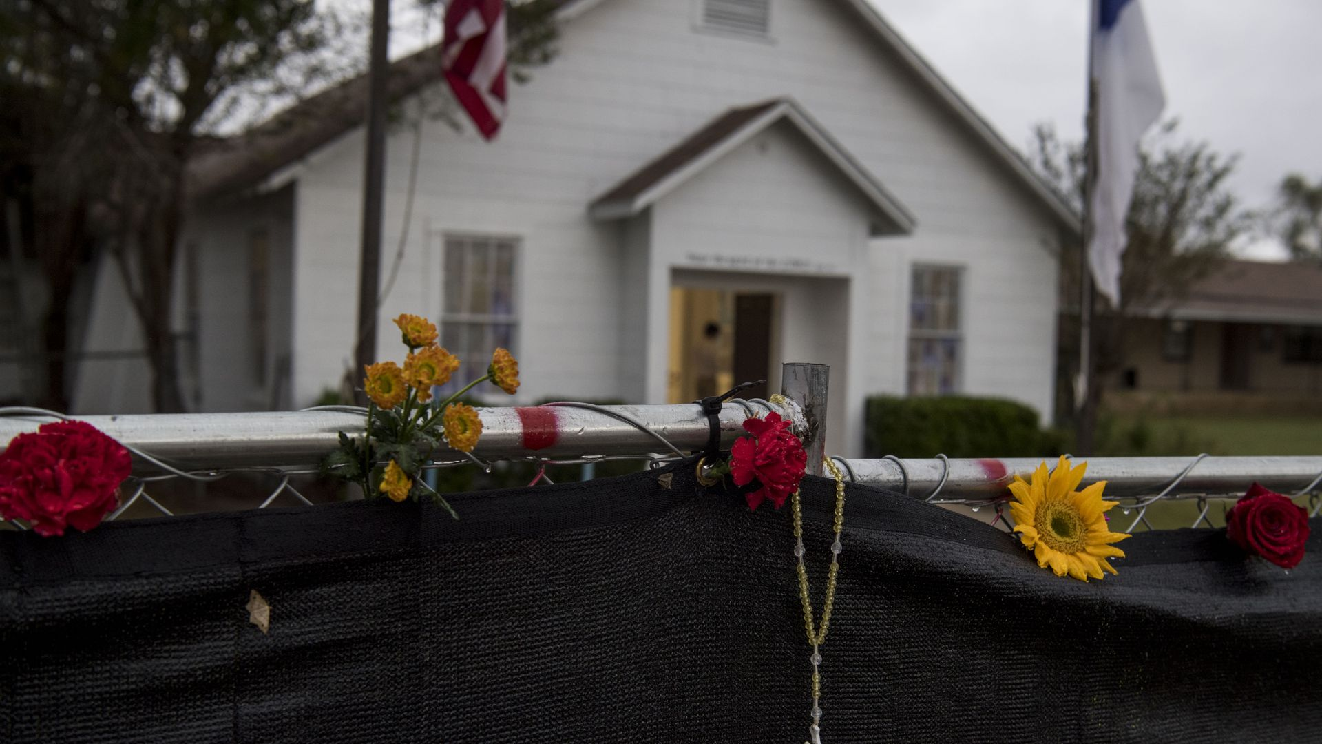A rosary hangs on the fence outside the Sutherland Springs First Baptist Church.