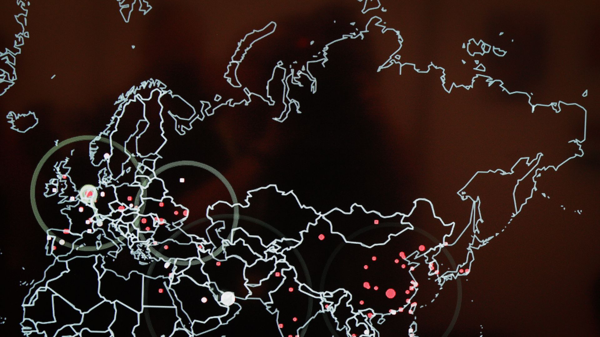 Map showing red pinpoints at certain cities around the world