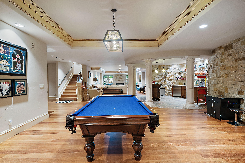 A blue felt pool table in the basement