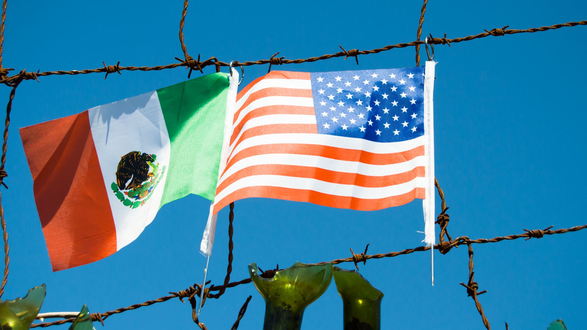 Mexican and American flags at the southern border