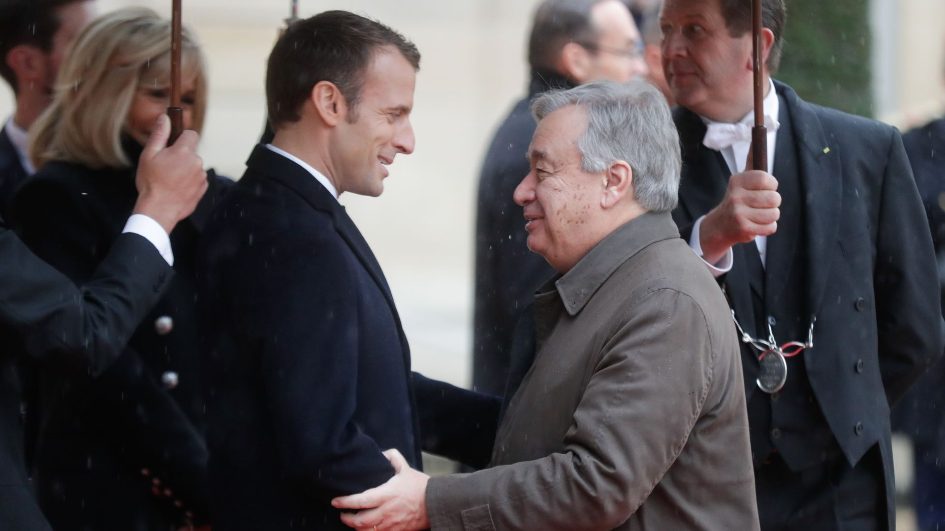 Macron shaking hands with Antonio Guterres
