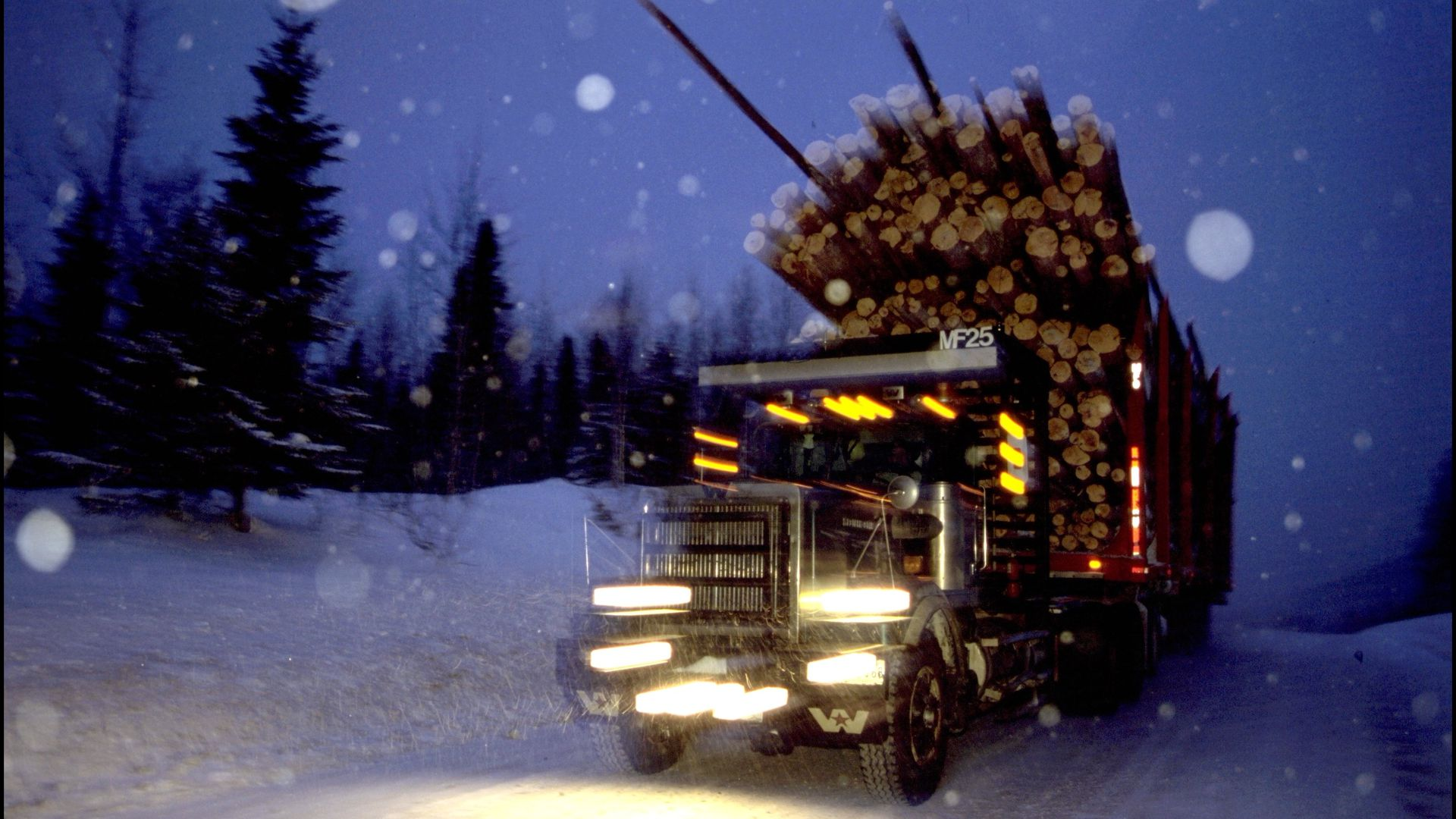 Truck carrying lumber in the snow
