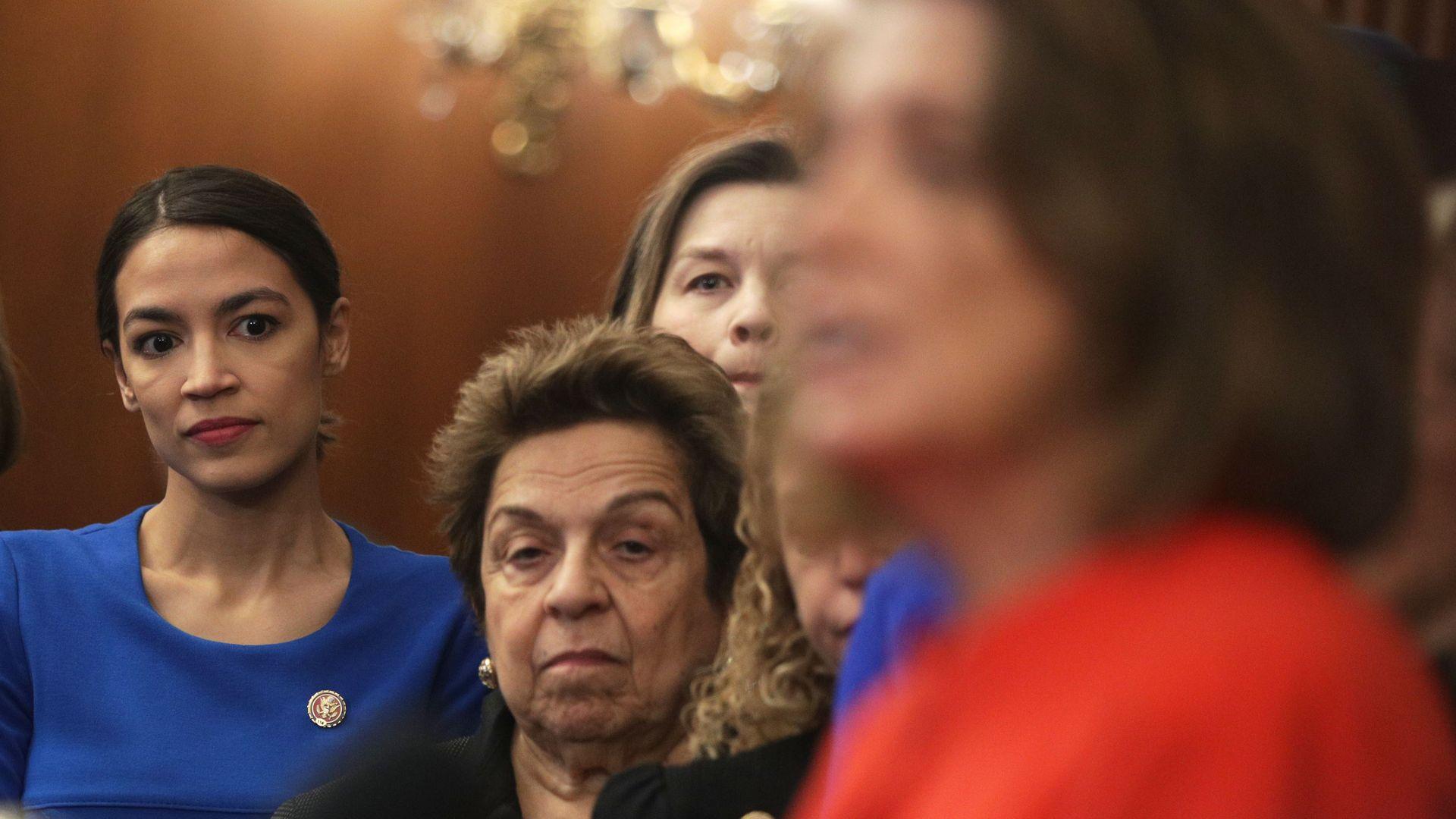 U.S. Rep. Kathy Castor (D-FL), Rep. Alexandria Ocasio-Cortez (D-NY), and Rep. Donna Shalala (D-FL) listen as Speaker of the House Rep. Nancy Pelosi (D-CA) speak.
