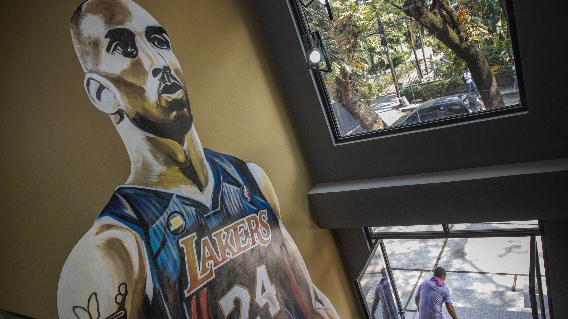 In this image Kobe Bryant is pictured in a mural on the wall in a stairwell