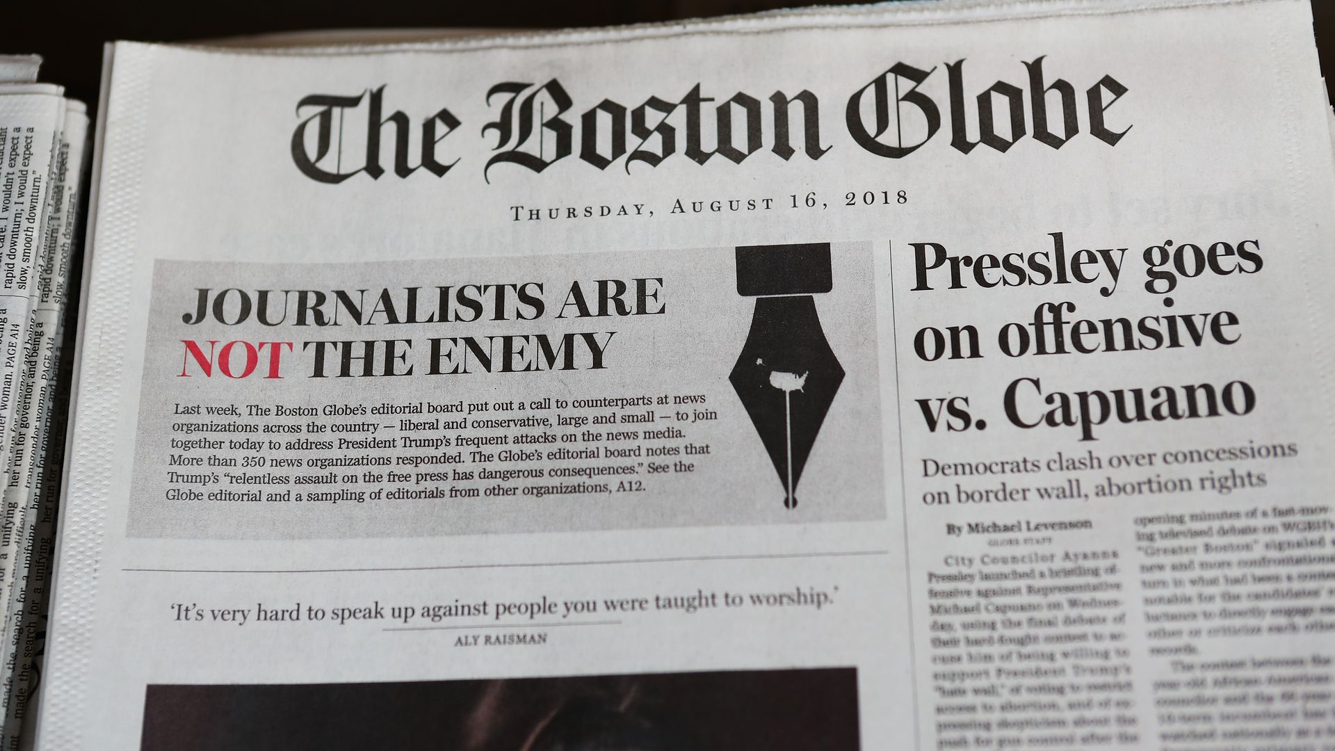 "Boston Globe's front page that reads, ""Journalists are not the enemy."""