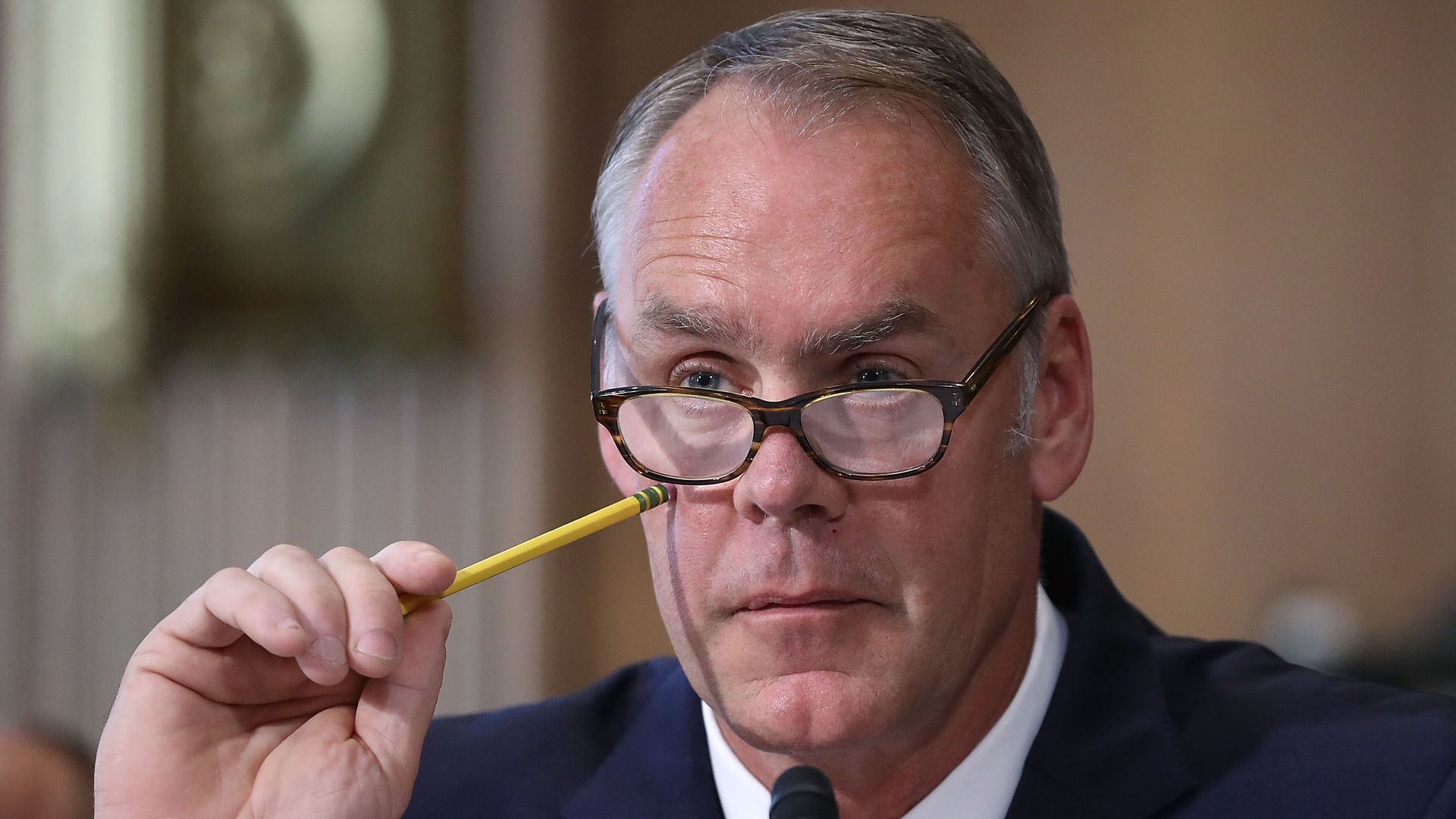 Interior Secretary Ryan Zinke listens to a question during a Senate Energy and Natural Resources Committee hearing on Capitol Hill.
