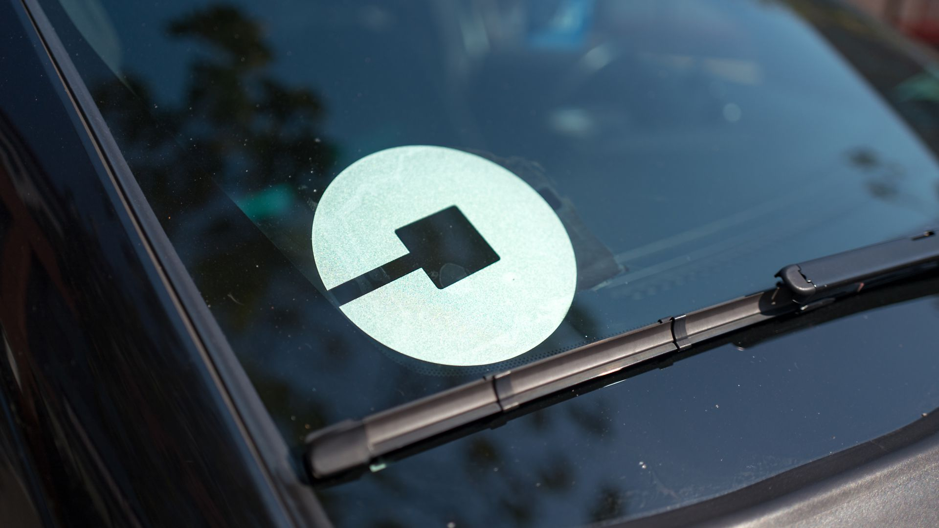Car windshield with Uber logo.