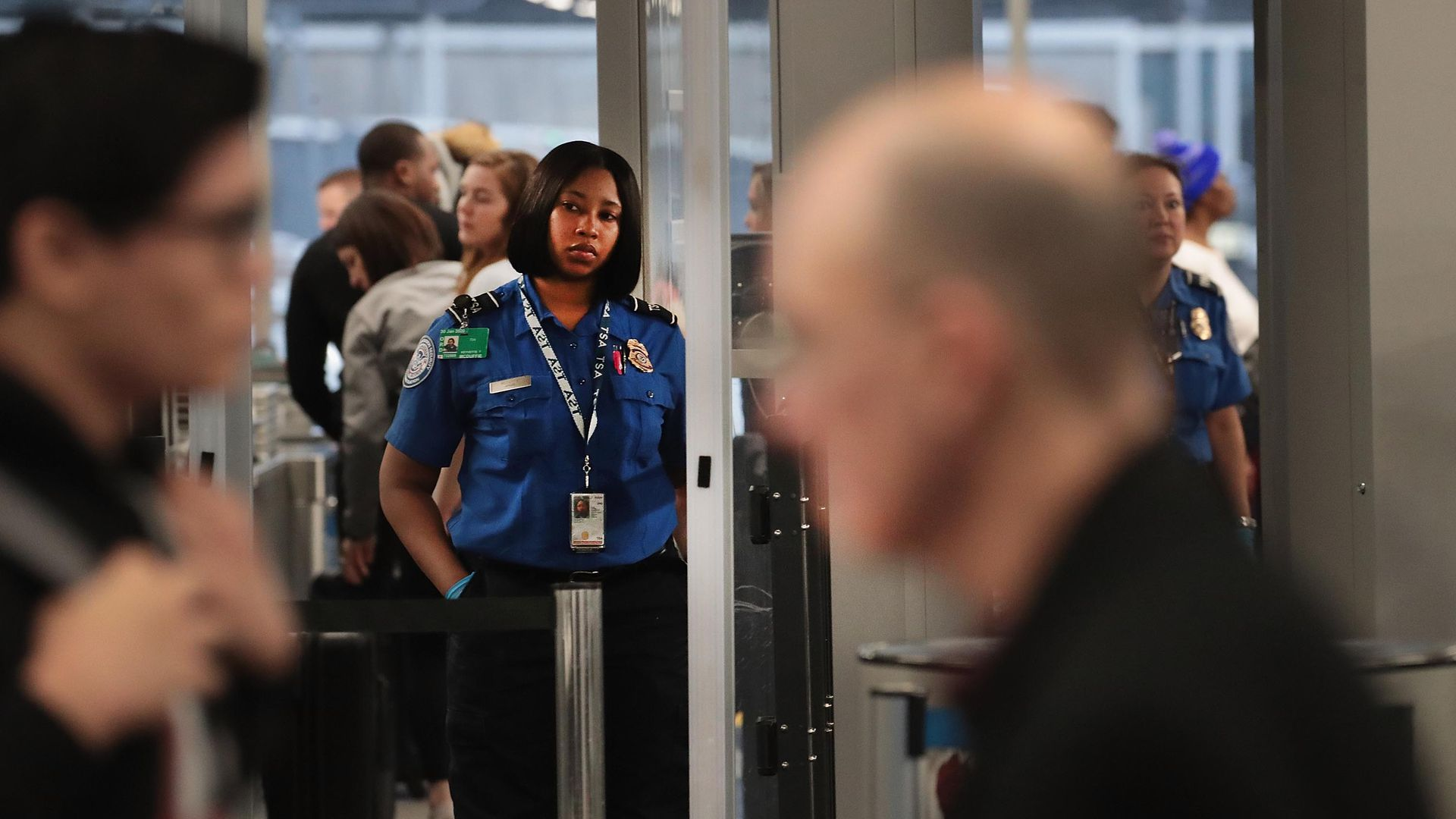 A Transportation Security Administration (TSA) worker screens passengers and airport employees at O'Hare International Airport  in Chicago, Illinois.