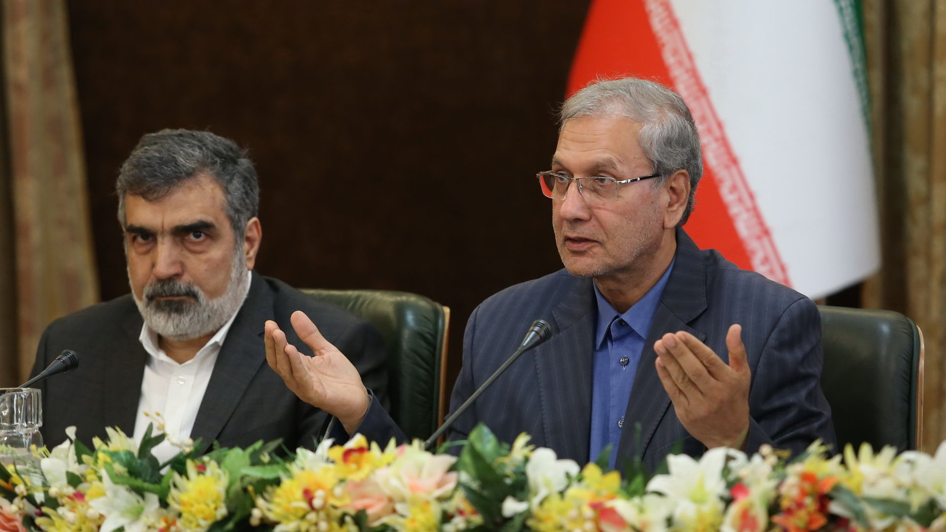 Behrouz Kamalvandi and Ali Rabiei seated while giving a press conference