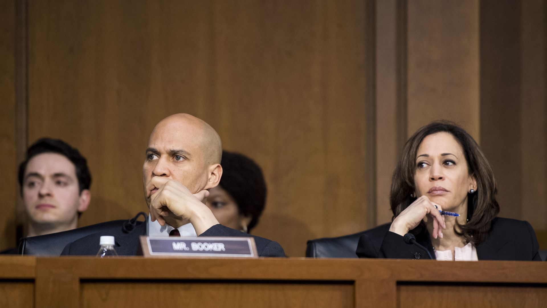 Senators Booker and Harris look stern.
