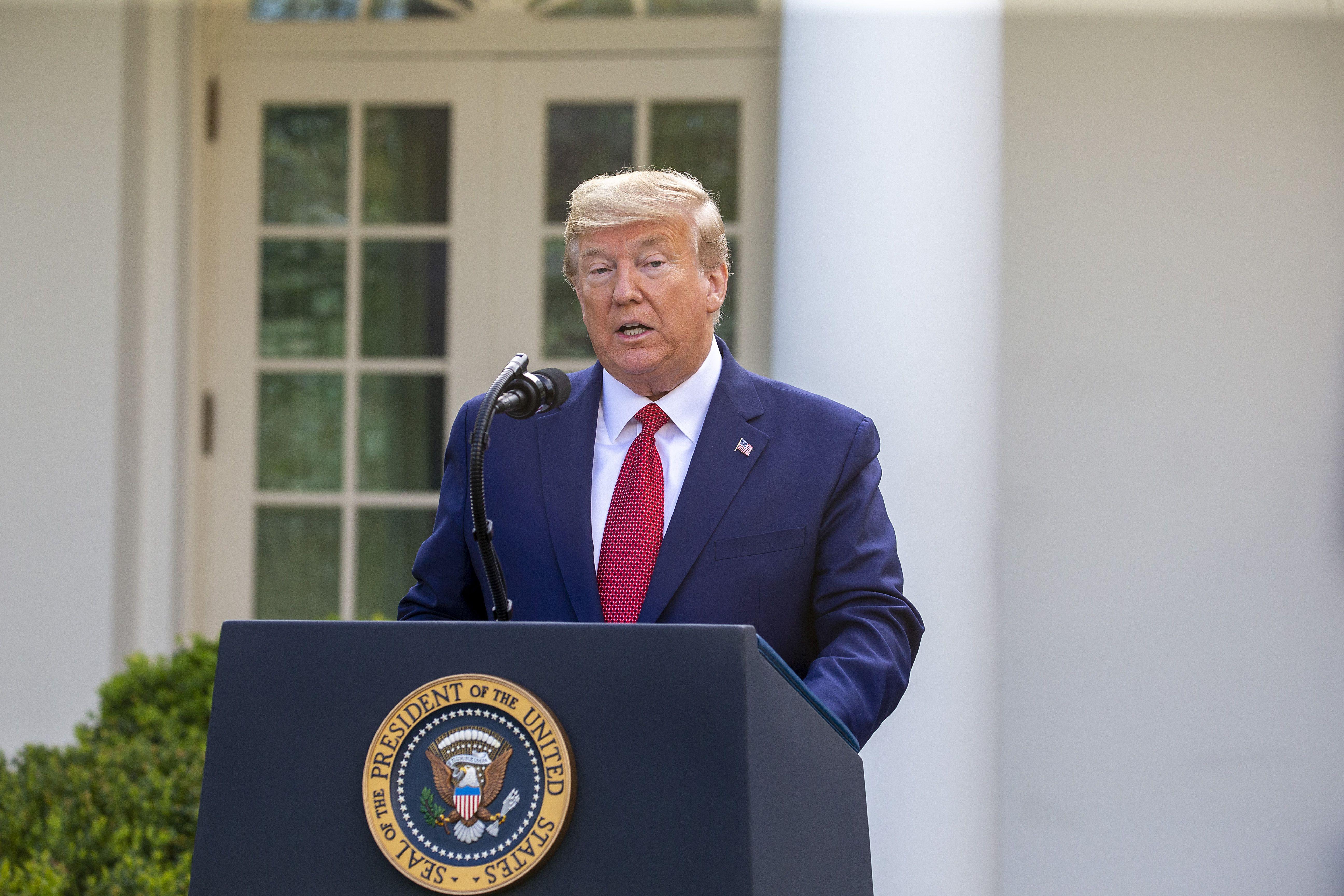 Trump says peak coronavirus deaths in 2 weeks, extends shutdown