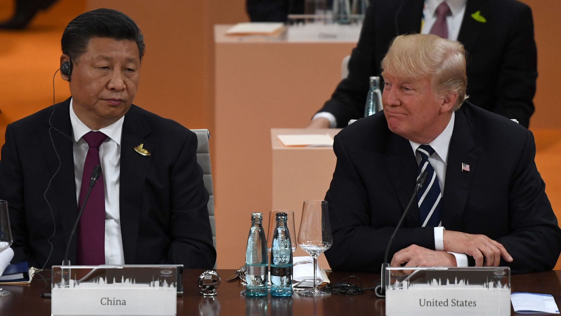 China's President Xi Jinping (L) and US President Donald Trump attend a working session on the first day of the G20 summit in Hamburg, northern Germany, on July 7, 2017.