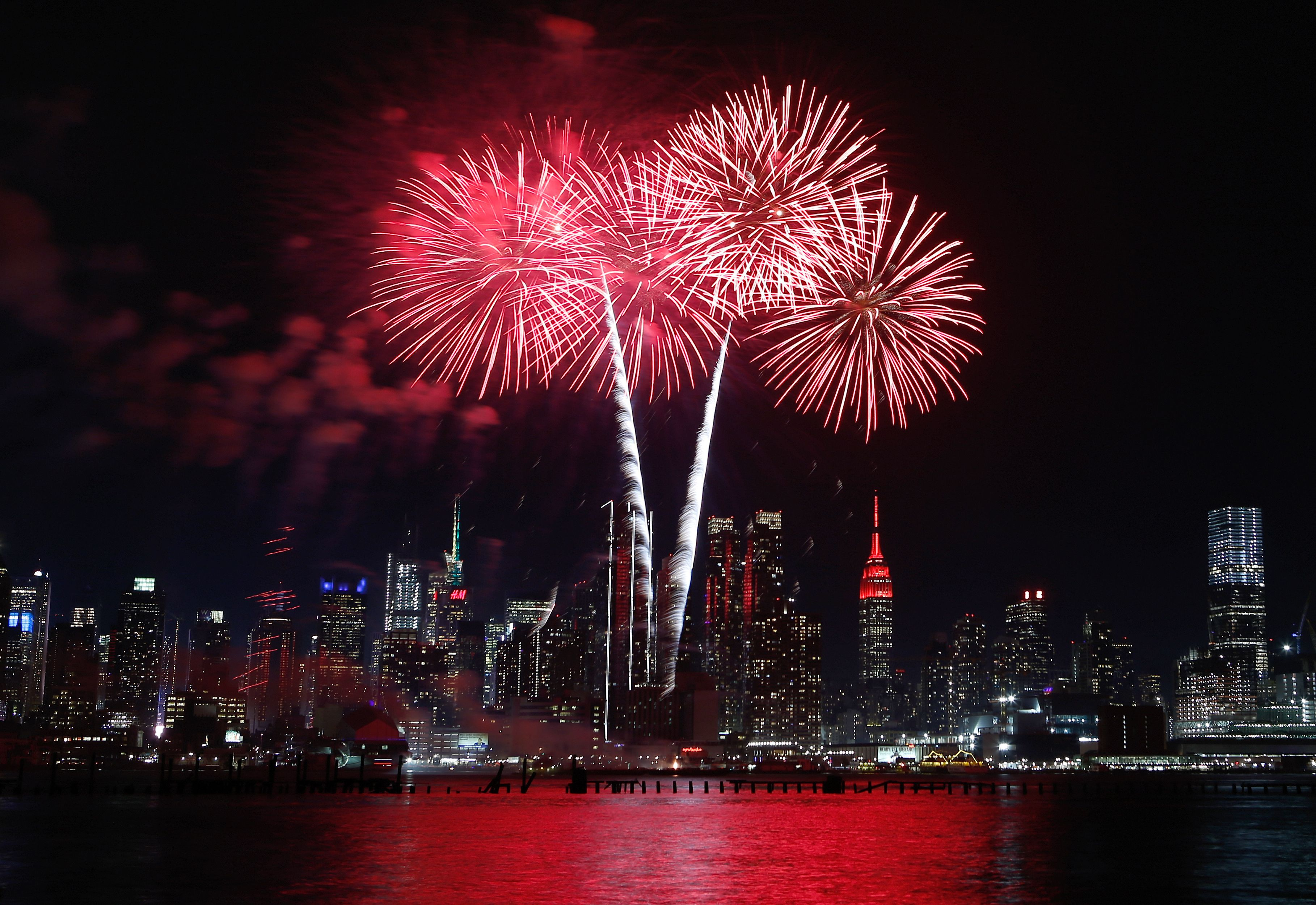 In this illustration, two bursts of fireworks light up New Yorks skyline