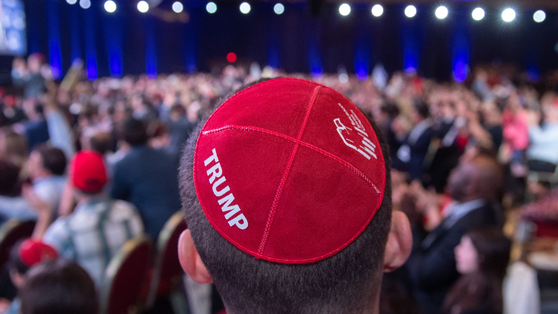 A man wears a Trump yarmulke prior to a speech by Trump during the Republican Jewish Coalition.
