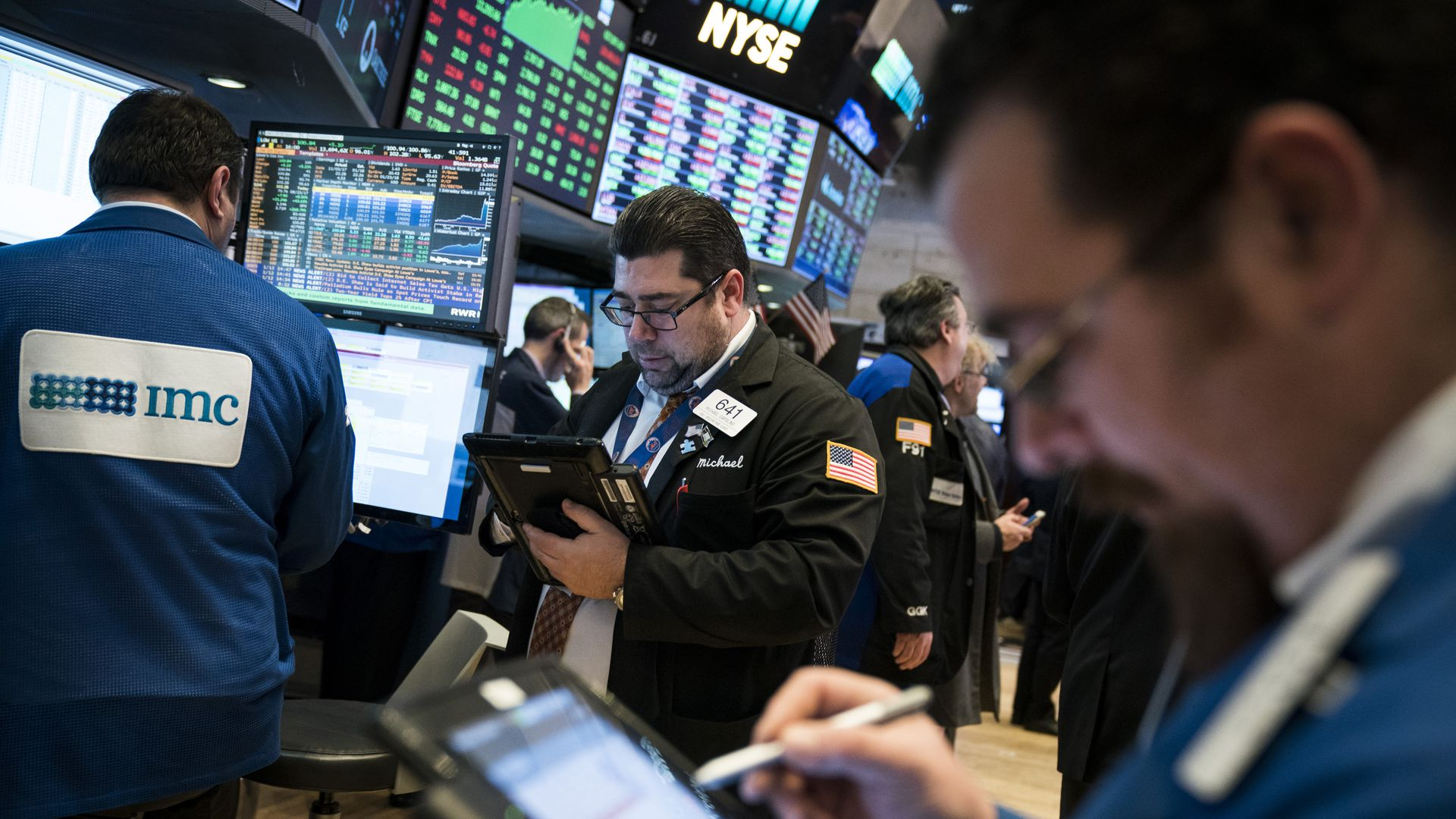Traders and financial professional work ahead of the closing bell on the floor of the New York Stock Exchange
